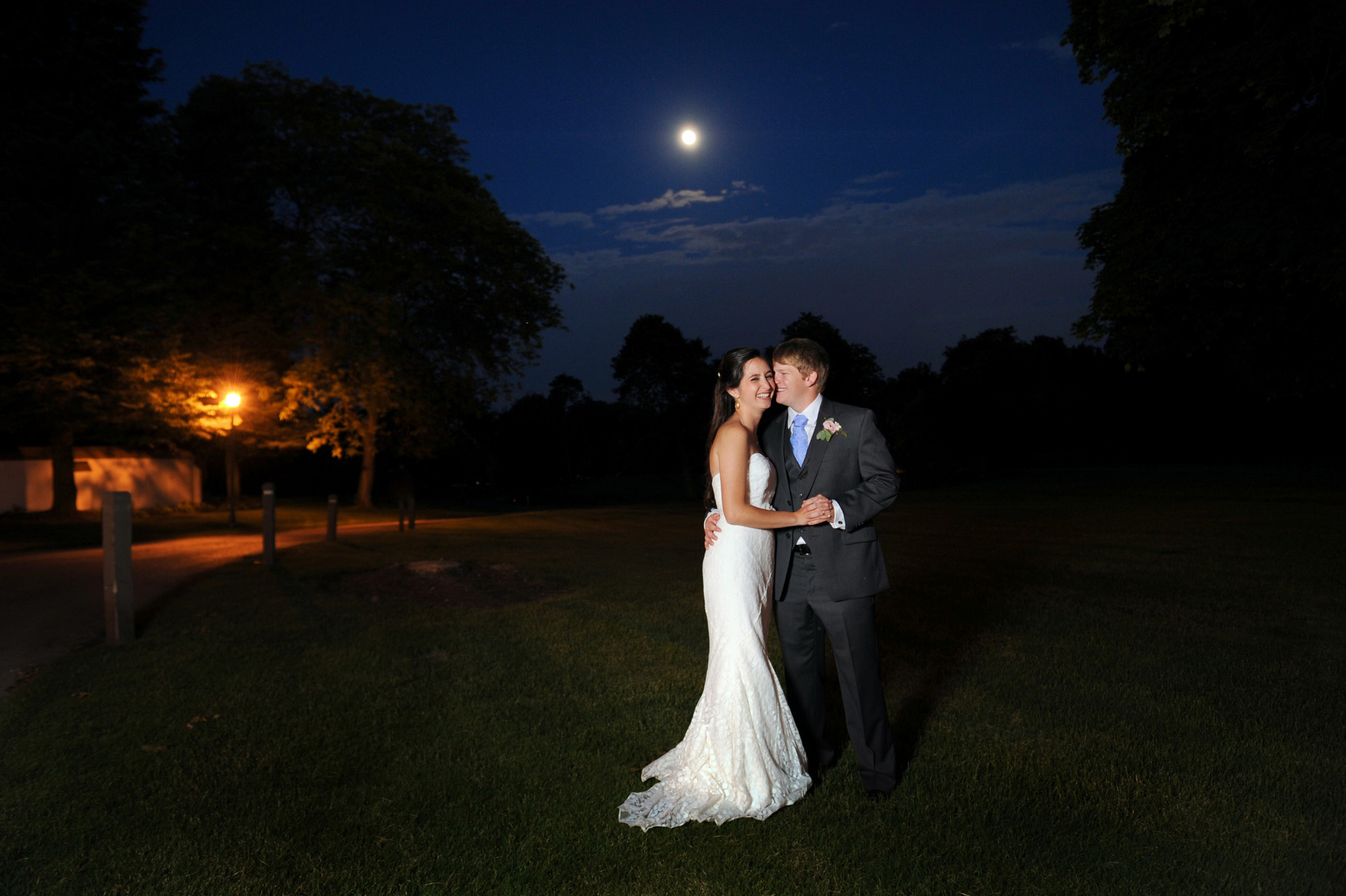 The Wedding couples who love candid wedding photos featuring fun photojournalistic moments wedding photographs in Romeo, Michigan highlights moving away from Addison Oaks to creating your unique wedding photography showing  the bride and groom on their full moonlit wedding night that emphasized photojournalist's moments.