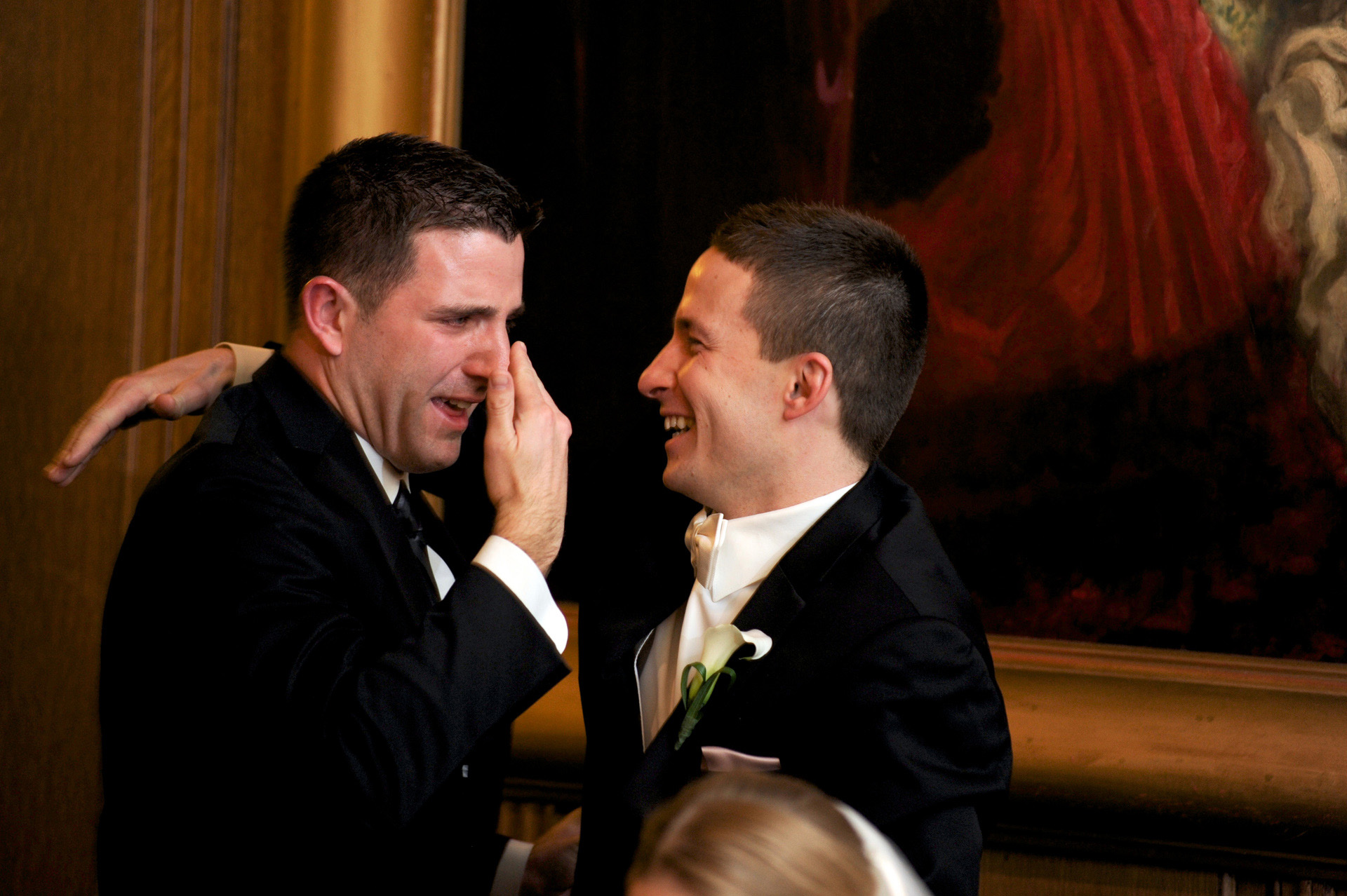 Michigan wedding at Detroit, Michigan, photograph of the groom hugging his crying best man after his speech at the Detroit Athletic Club.
