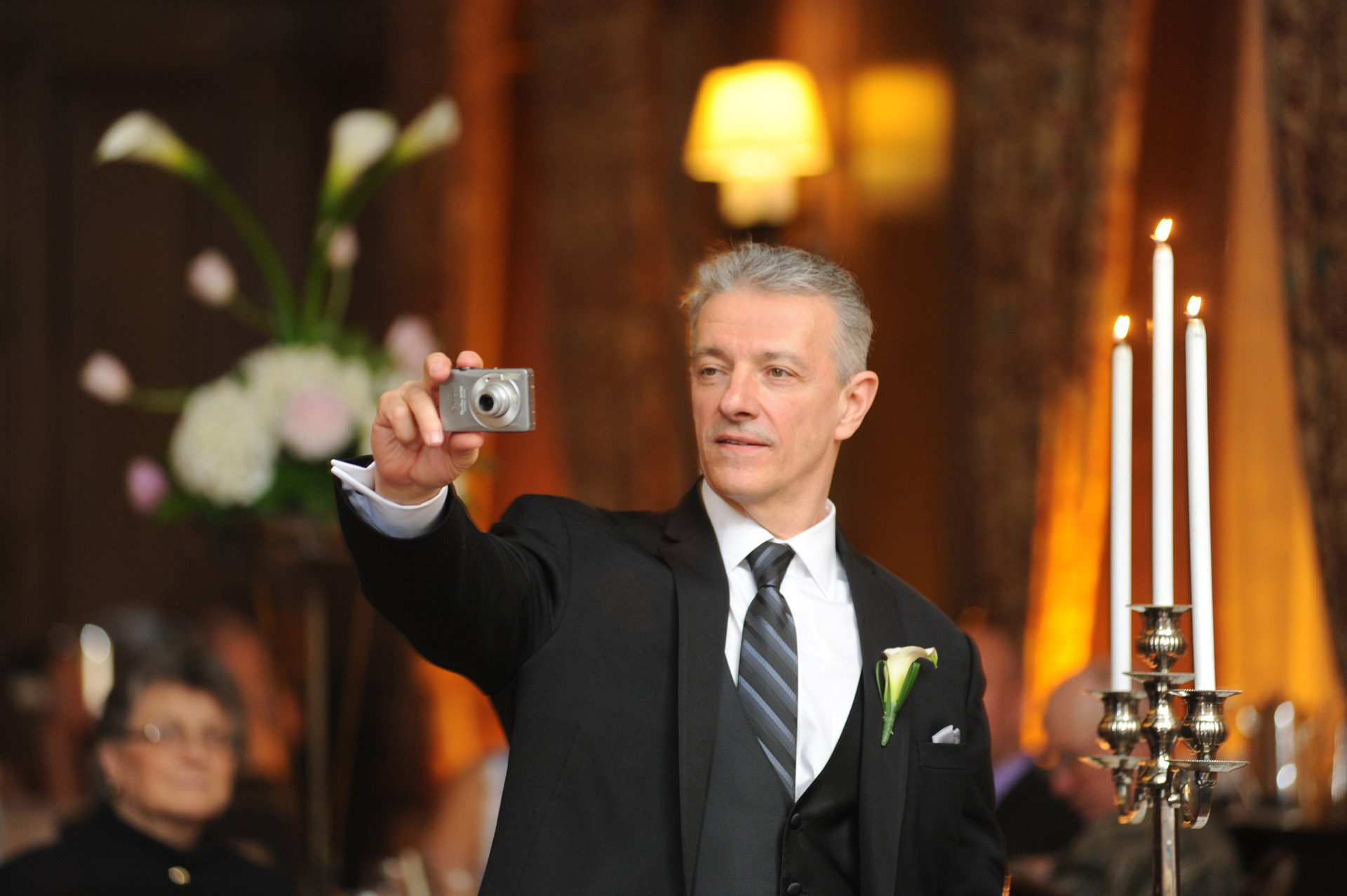 Michigan wedding in Detroit, Michigan, features the groom's father photographing the mother/son dance during the wedding reception at the Detroit Athletic Club.