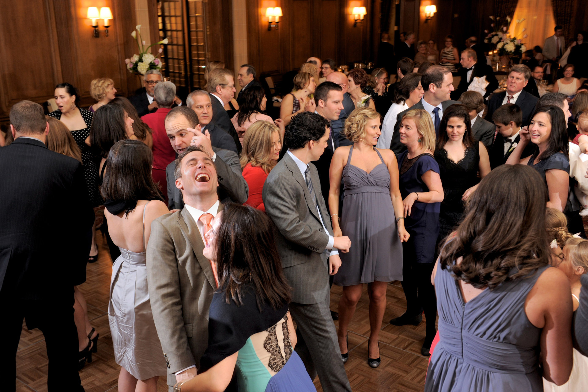 Michigan wedding in Detroit, Michigan, featured the bride and groom's guests filling the dance floor during their wedding reception at the Detroit Athletic Club.
