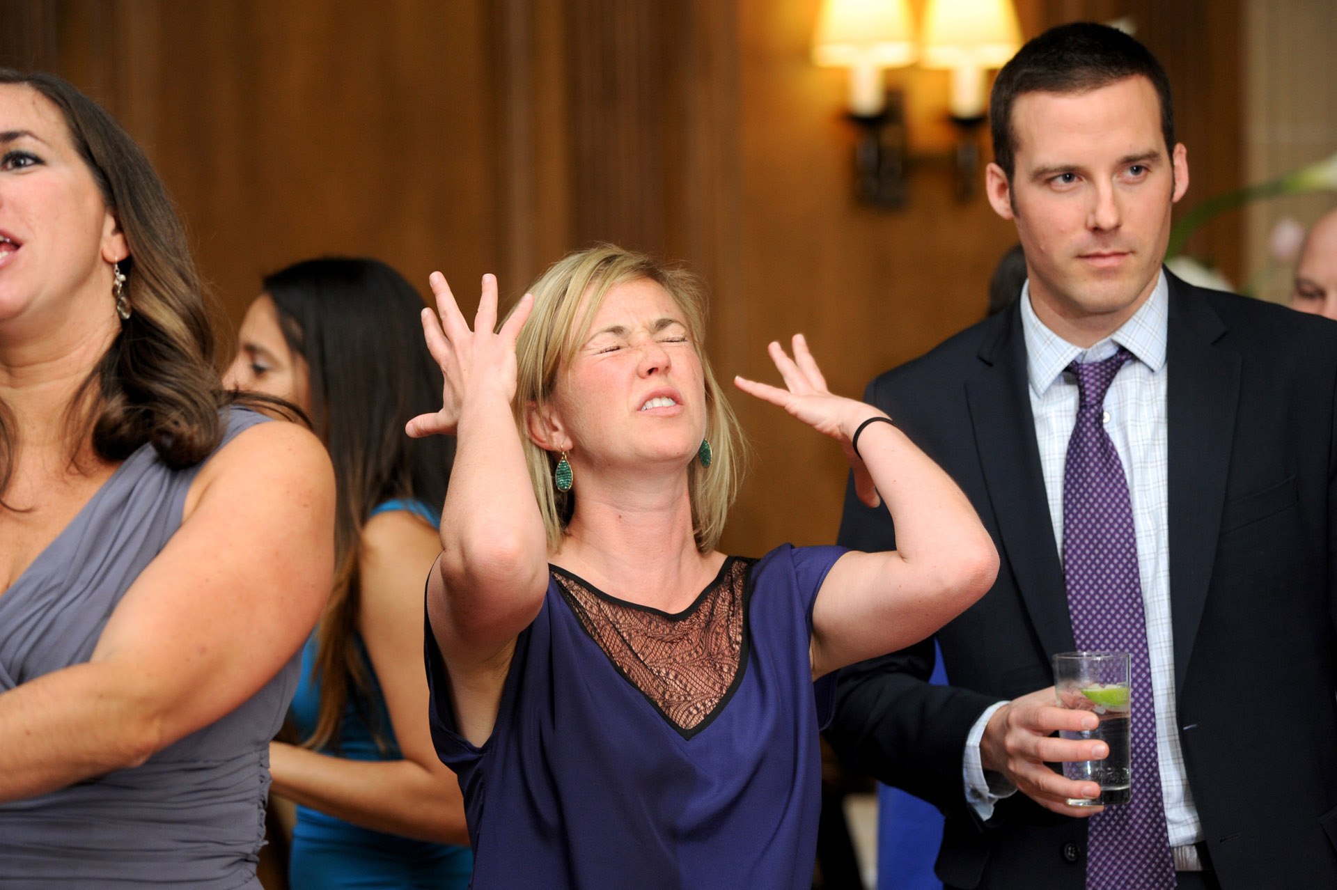 Michigan wedding in Detroit, Michigan, features guests dramatically dancing at the DAC or the Detroit Athletic Club.