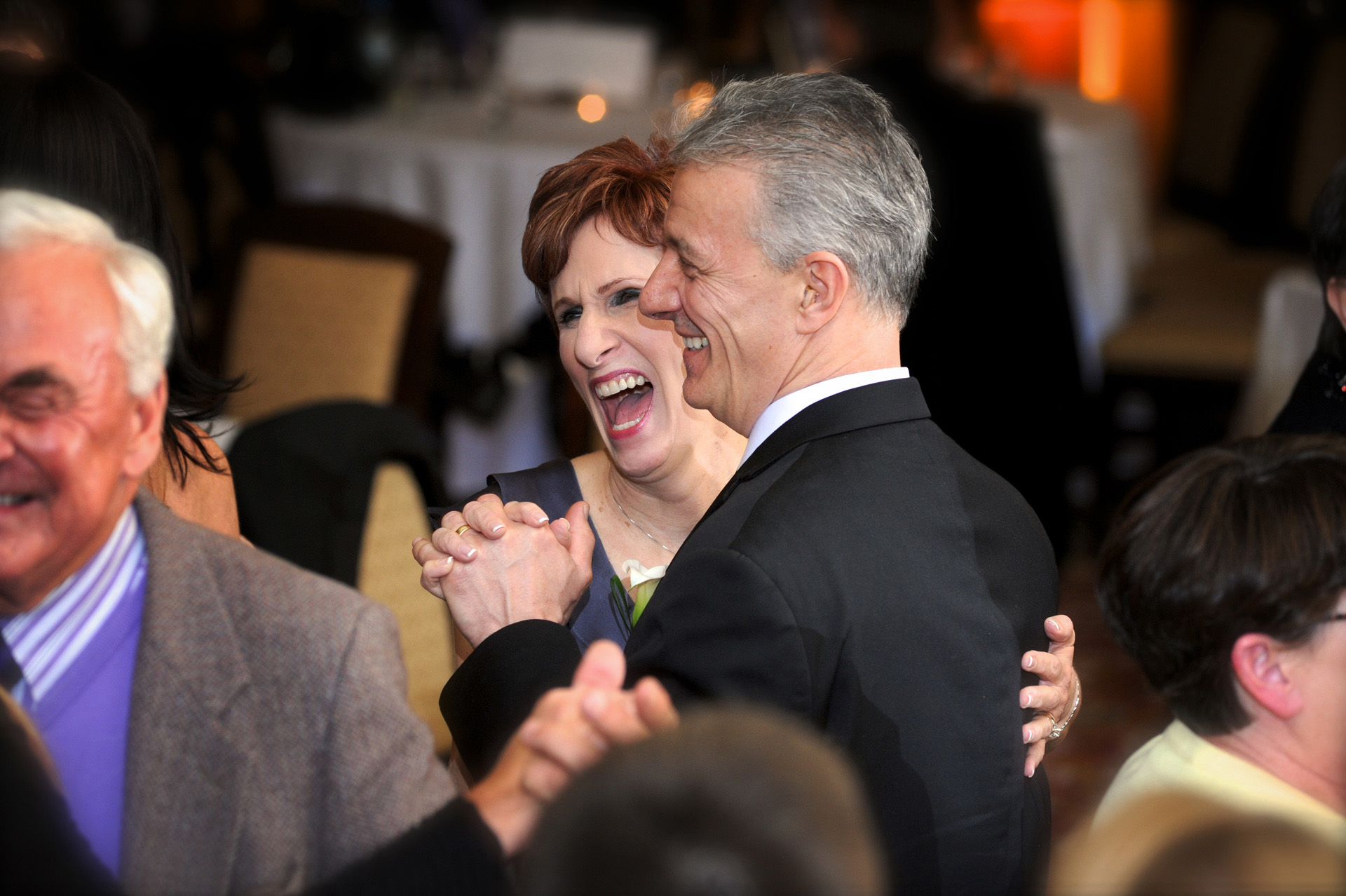 A windy winter wedding in Michigan features the groom's parents dancing during their son's wedding reception at the DAC or the Detroit Athletic Club.