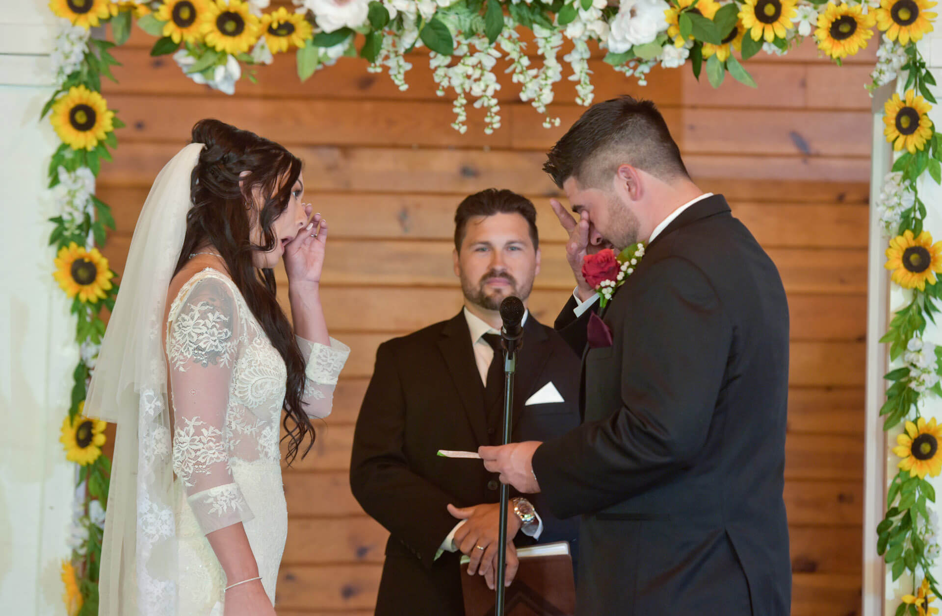 The bride and groom tear up during their vows downriver in Michigan during the pandemic.