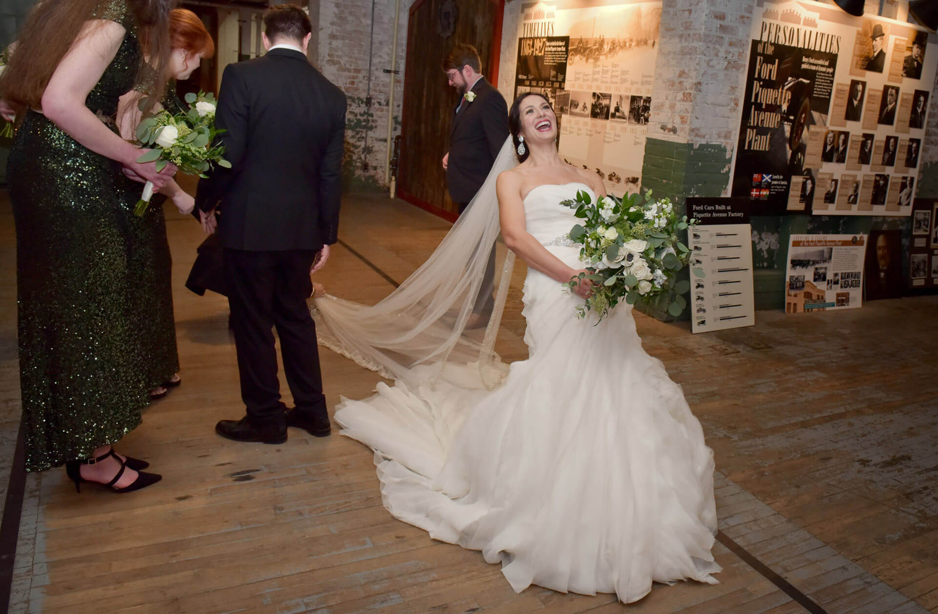 The bride's veil gets snagged on the floors during her winter wedding at the Ford Piquette Plant in Detroit, Michigan.