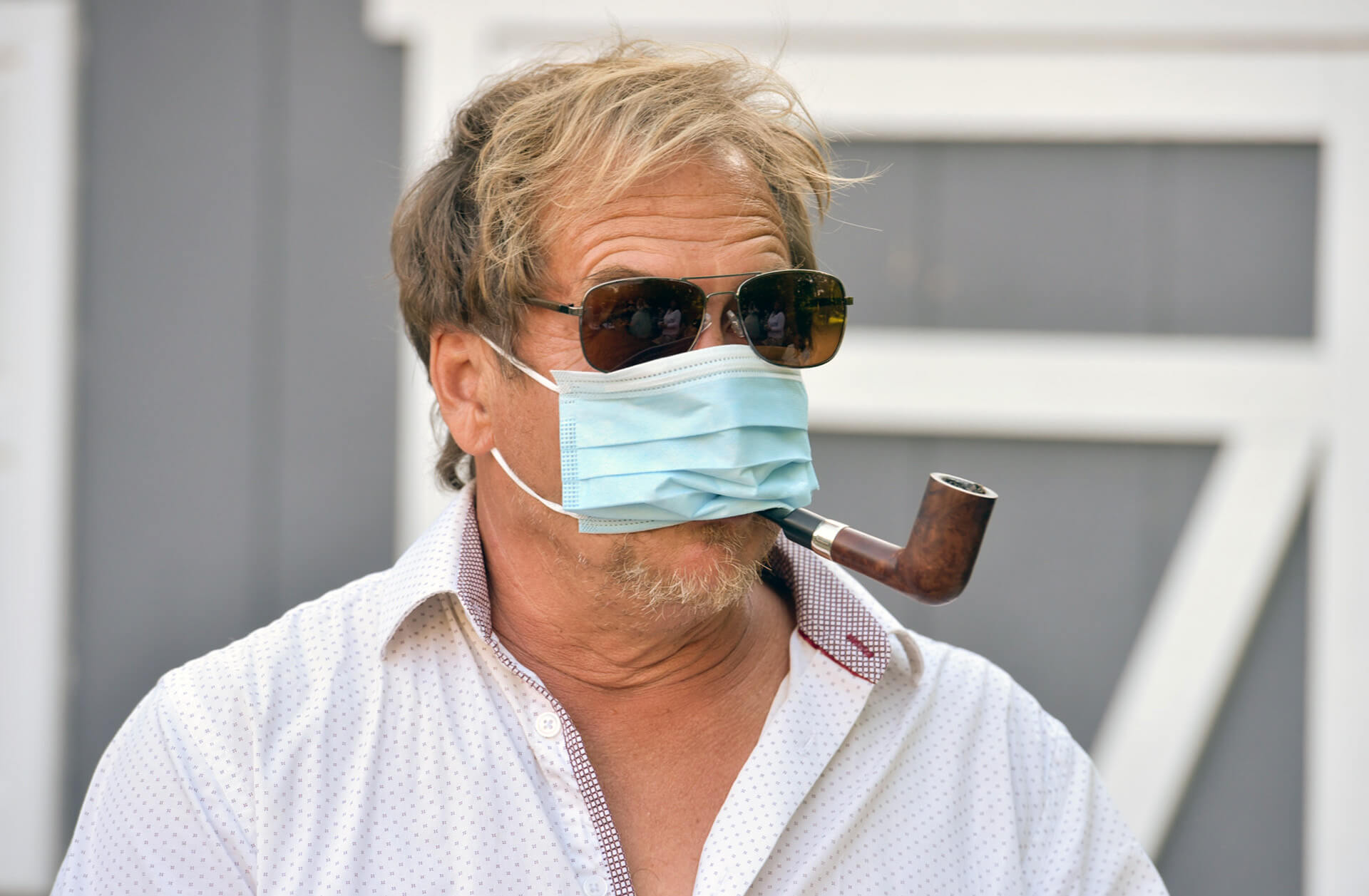 A guest tries (sort of ) to mask up during a wedding in Michigan during the pandemic.