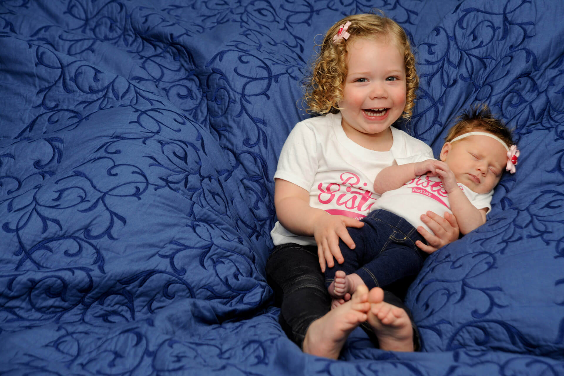Best Detroit baby photographer works with families to capture first photos with siblings in their metro Detroit, Michigan area homes for baby picture photo shoots.