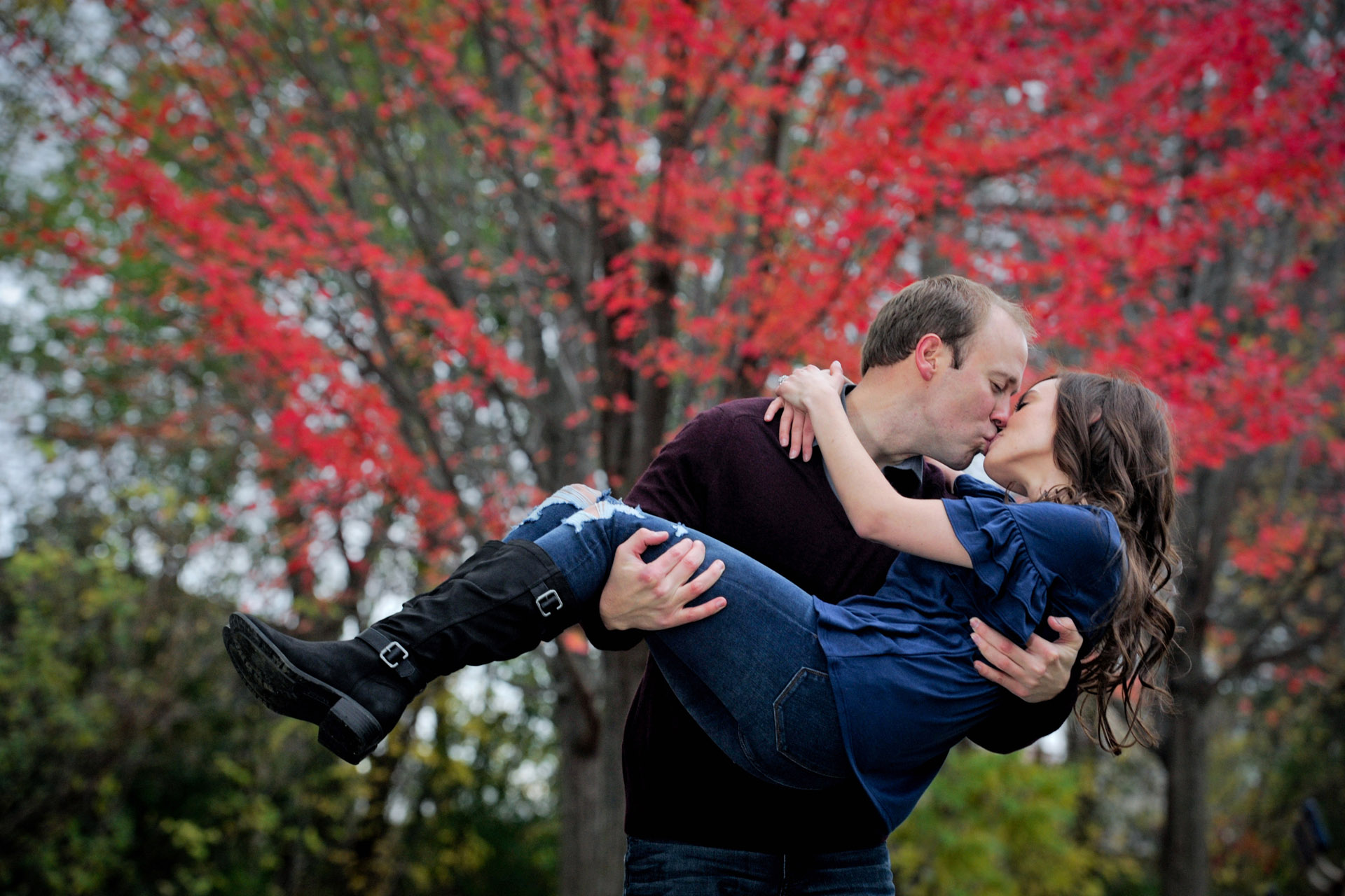 Best Detroit engagement photographer's fun and candid engagement photos combine romance and personality like this kiss with the red leaves in metro Detroit, Michigan.