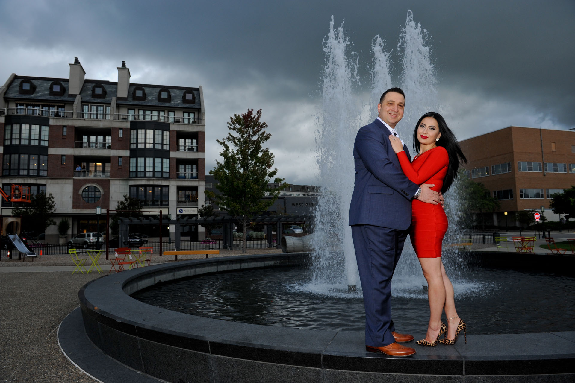 Best Detroit engagement photographer captures classic poses in bizarre places to take full advantage of things like an oncoming storm during this metro Detroit, Michigan engagement photography session.