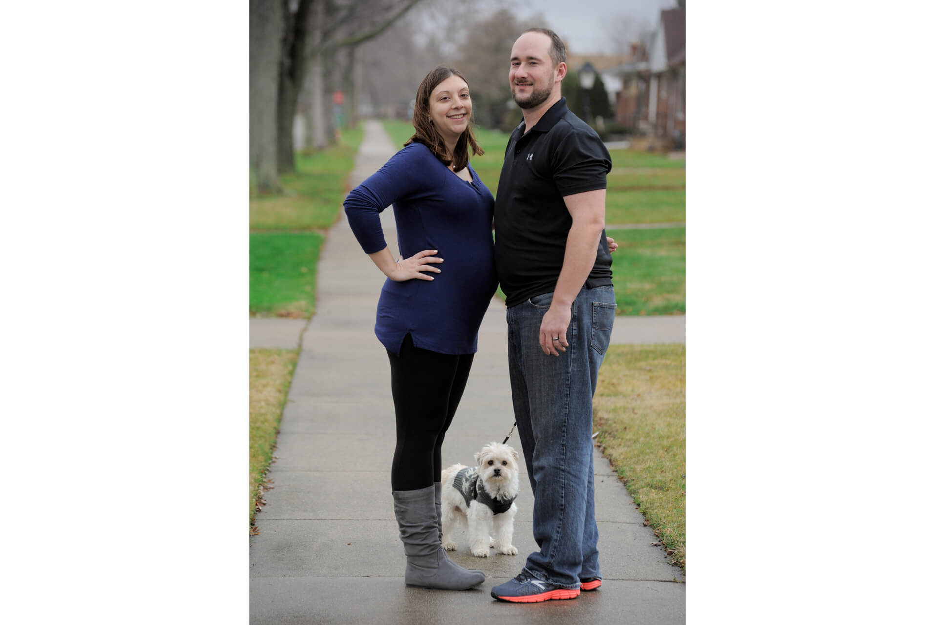 Best Detroit maternity photographer photographs a repeat client along with their dog during a maternity lifestyle photography session in metro Detroit, Michigan.