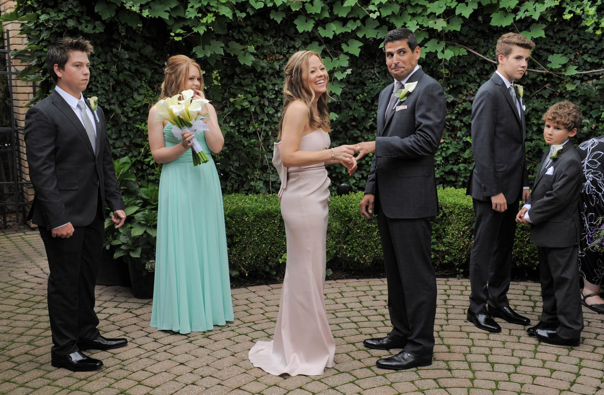 The groom says something wrong during his vows at his intimate family wedding at Cafe Cortina in Farmington Hills, Michigan.