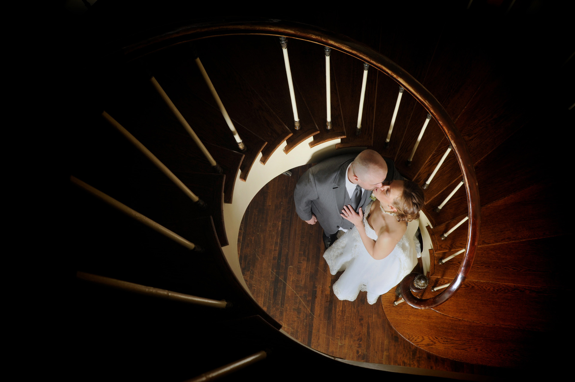Detroit, Michigan wedding photographer's photo of the wedding couple at the bottom of the stairs at the Colony Club.