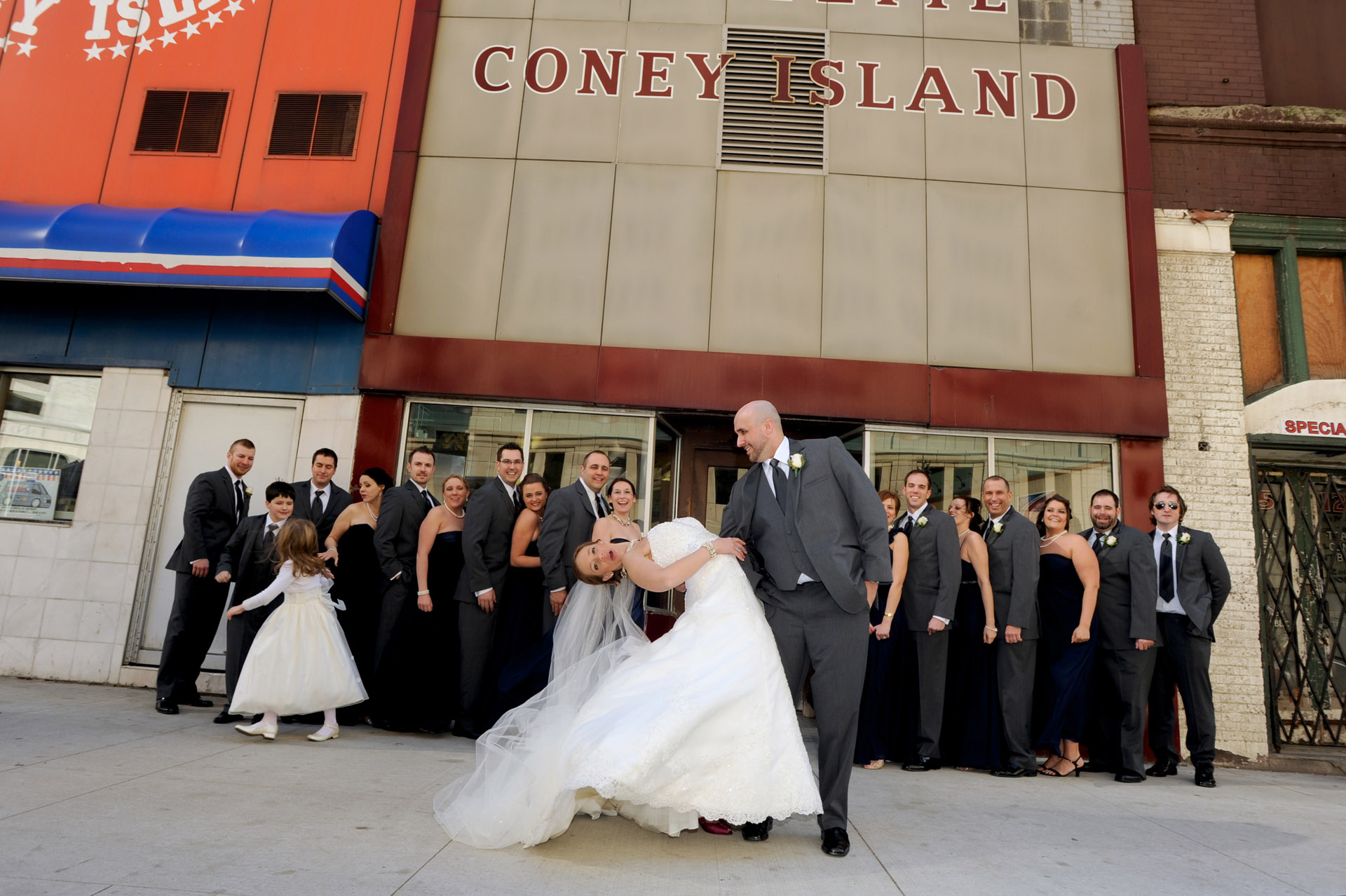 Detroit, Michigan wedding photographer's photo of the wedding party in front of Lafayette Coney Island in Detroit, Michigan.