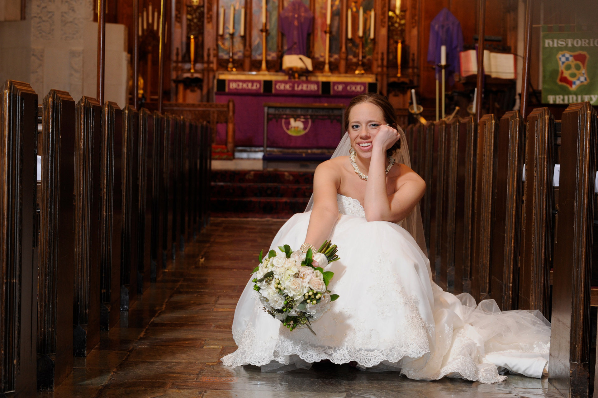 Colony Club wedding photographer's photo of Mindy taking a rest after her Detroit, Michigan wedding ceremony at the Historic Trinity Lutheran Church in Detroit.