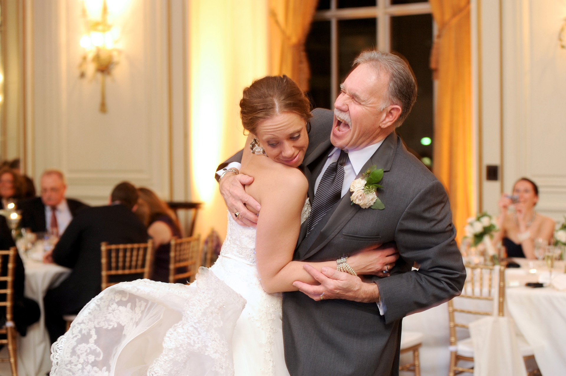 Colony Club wedding photographer's photo of Mindy and her father goof around during their father/daughter dance during the wedding reception at the Colony Club in Detroit, Michigan.