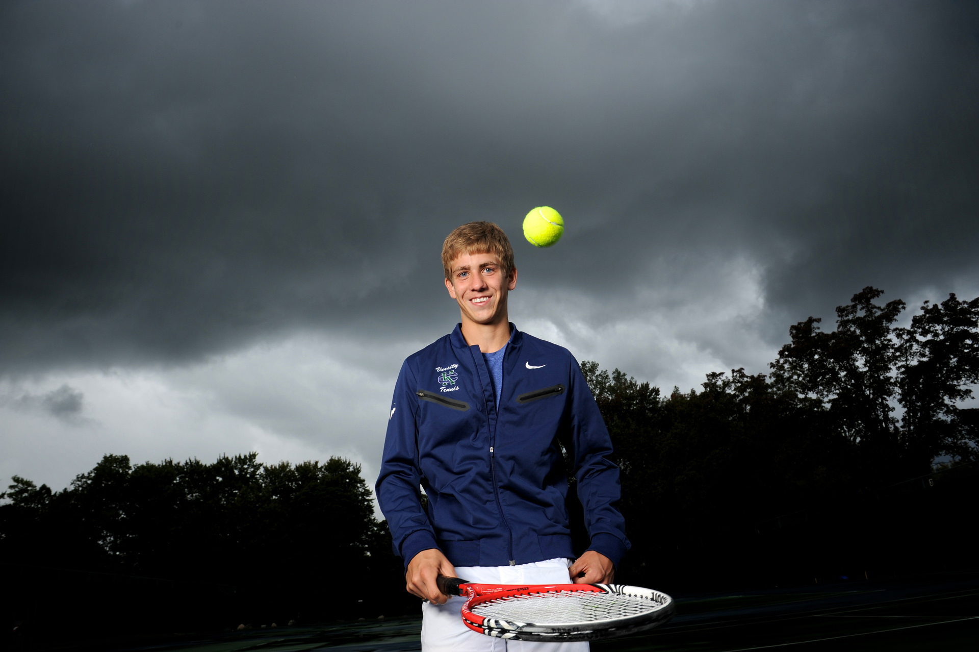 cranbrook, Michigan senior photographer's photo taken of a tennis player in a storm at Cranbrook School in Bloomfield, Michigan.