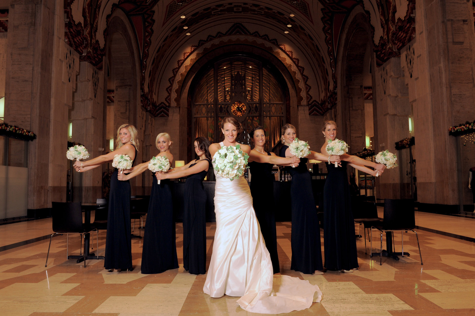 The Historic church Sweetest Heart of Mary and the Dearborn Inn of Detroit's historic church in Detroit and Dearborn, Michigan wedding photographer's photo of the bride and her bridesmaids at the historic Guardian building for wedding photos in Detroit, Michigan.