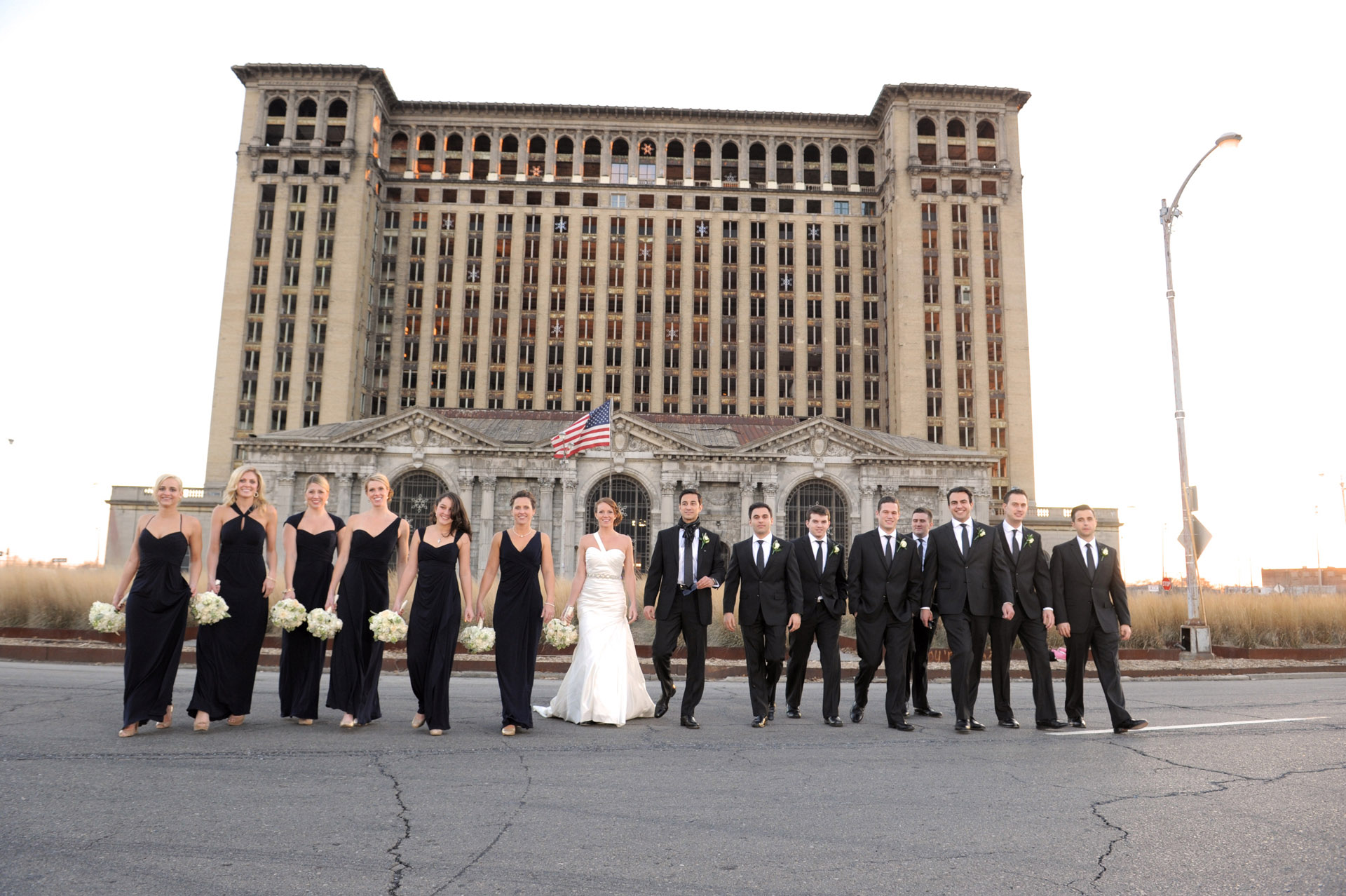 The Historic church Sweetest Heart of Mary and the Dearborn Inn of Detroit's historic church in Detroit and Dearborn, Michigan wedding photographer's photo of the photo of the wedding party at Detroit's historic train station for wedding photos in Detroit, Michigan.