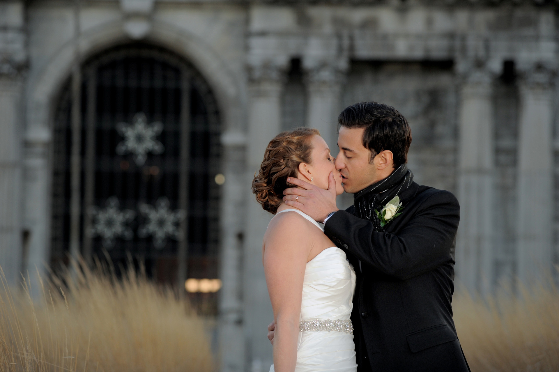 The Historic church Sweetest Heart of Mary and the Dearborn Inn of Detroit's historic church in Detroit and Dearborn, Michigan wedding photographer's photo of the wedding couple at Detroit's historic train station for wedding photos in Detroit, Michigan.