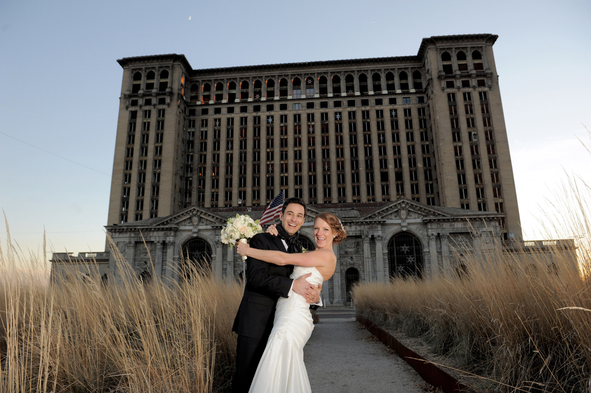The Historic church Sweetest Heart of Mary and the Dearborn Inn of Detroit's historic church in Detroit and Dearborn, Michigan wedding photographer's photo of the the bride and groom at Detroit's historic train station for wedding photos in Detroit, Michigan.