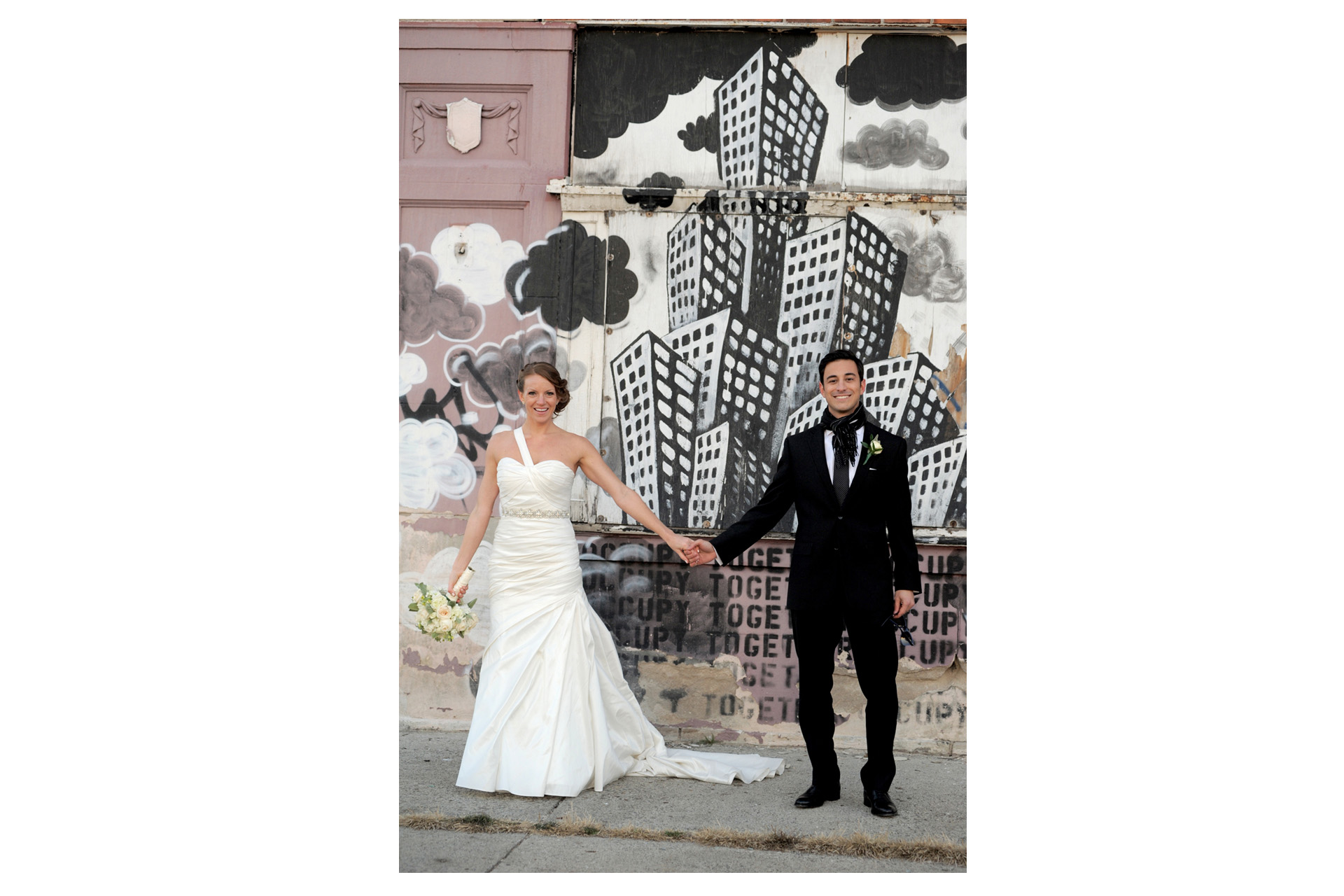 The Historic church Sweetest Heart of Mary and the Dearborn Inn of Detroit's historic church in Detroit and Dearborn, Michigan wedding photographer's photo of the couple near the Detroit's historic train station for wedding photos in Detroit, Michigan with local graffiti art.