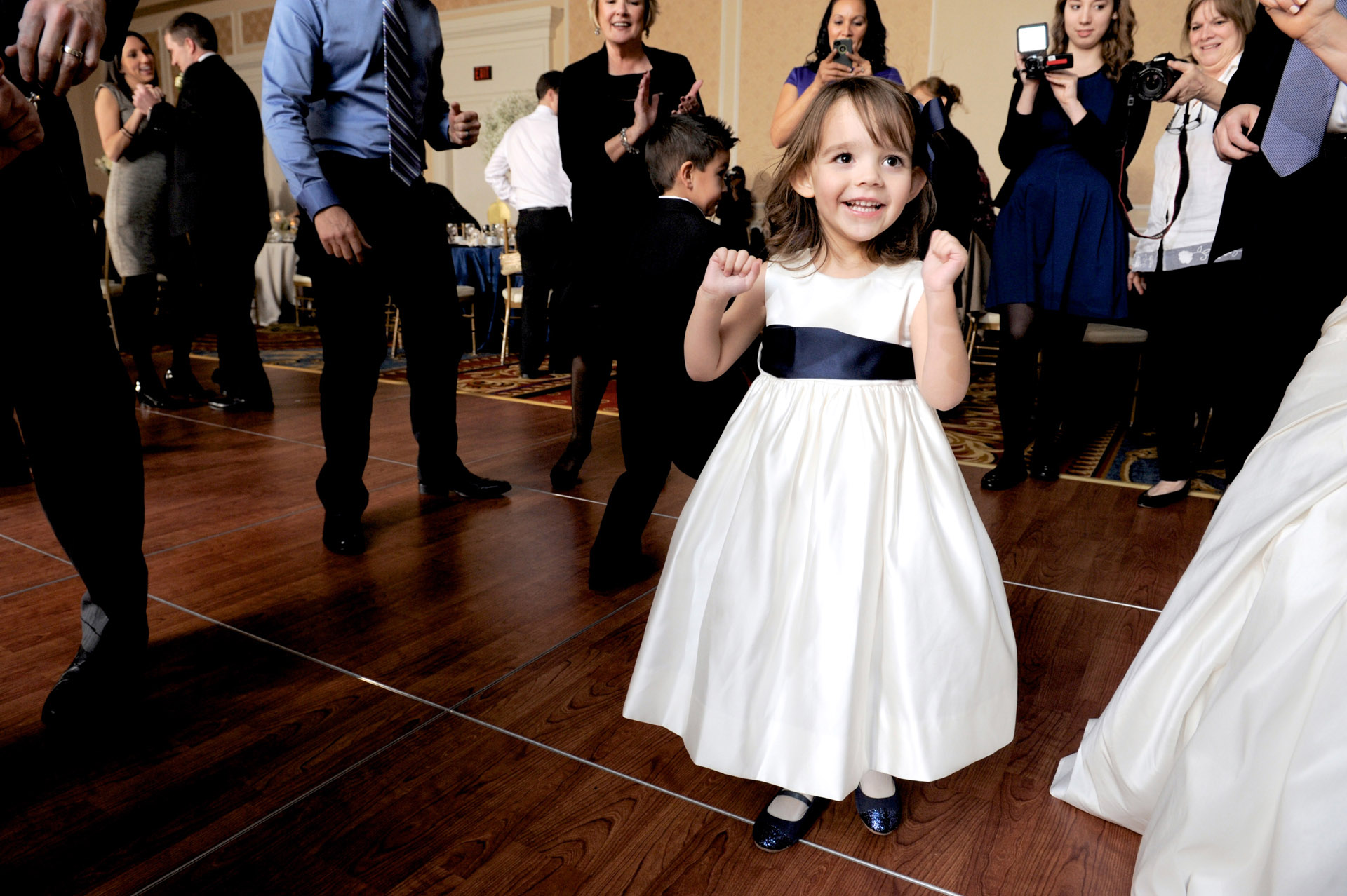 The Historic church Sweetest Heart of Mary and the Dearborn Inn of Detroit's historic church in Detroit and Dearborn, Michigan wedding photographer's photo of a couple of the flower girl dancing at the wedding reception at the Dearborn Inn in Dearborn, Michigan.