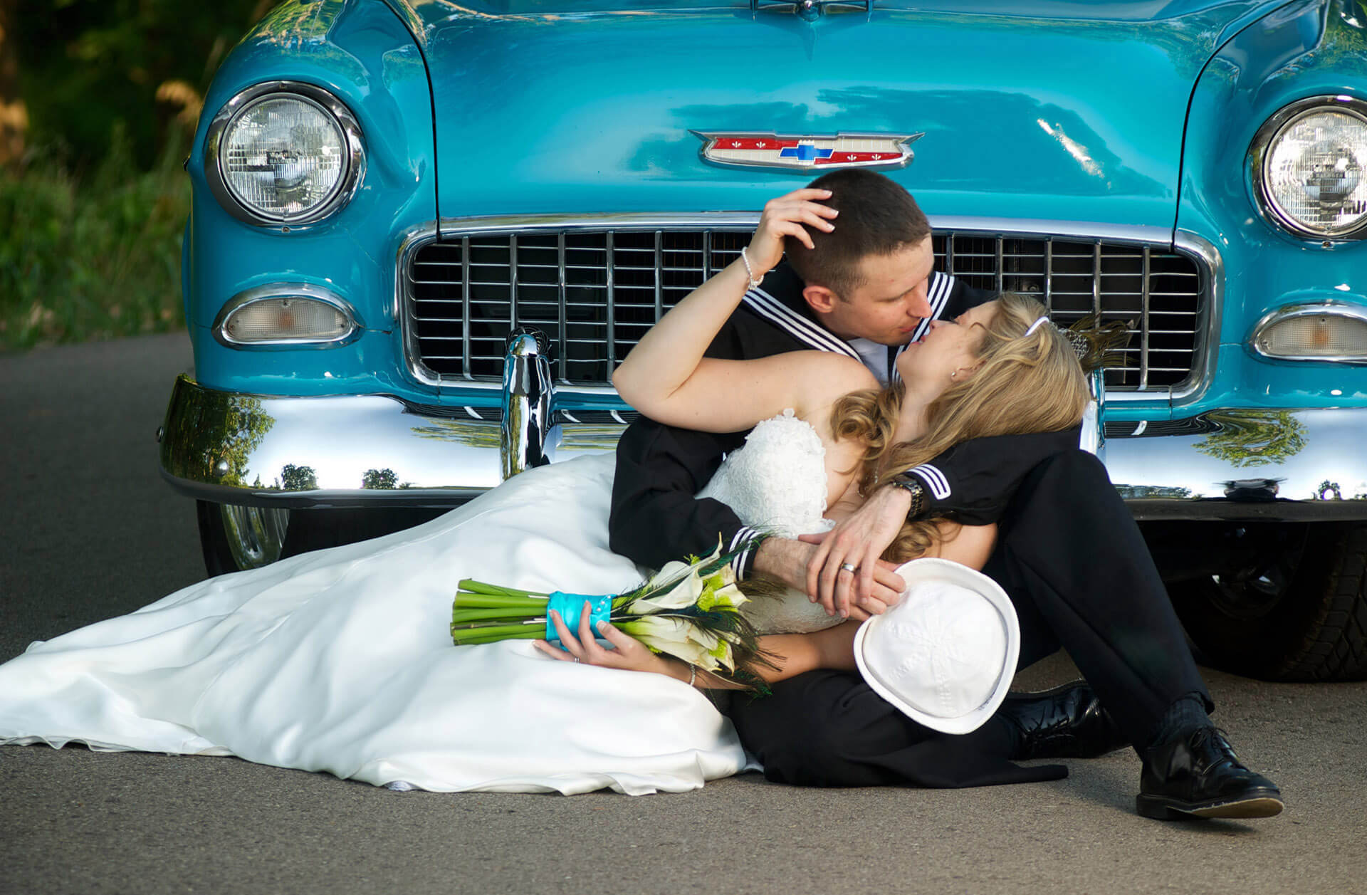 michigan wedding photographer takes romantic photos of michigan couple in front of an antique car in Ann Arbor.