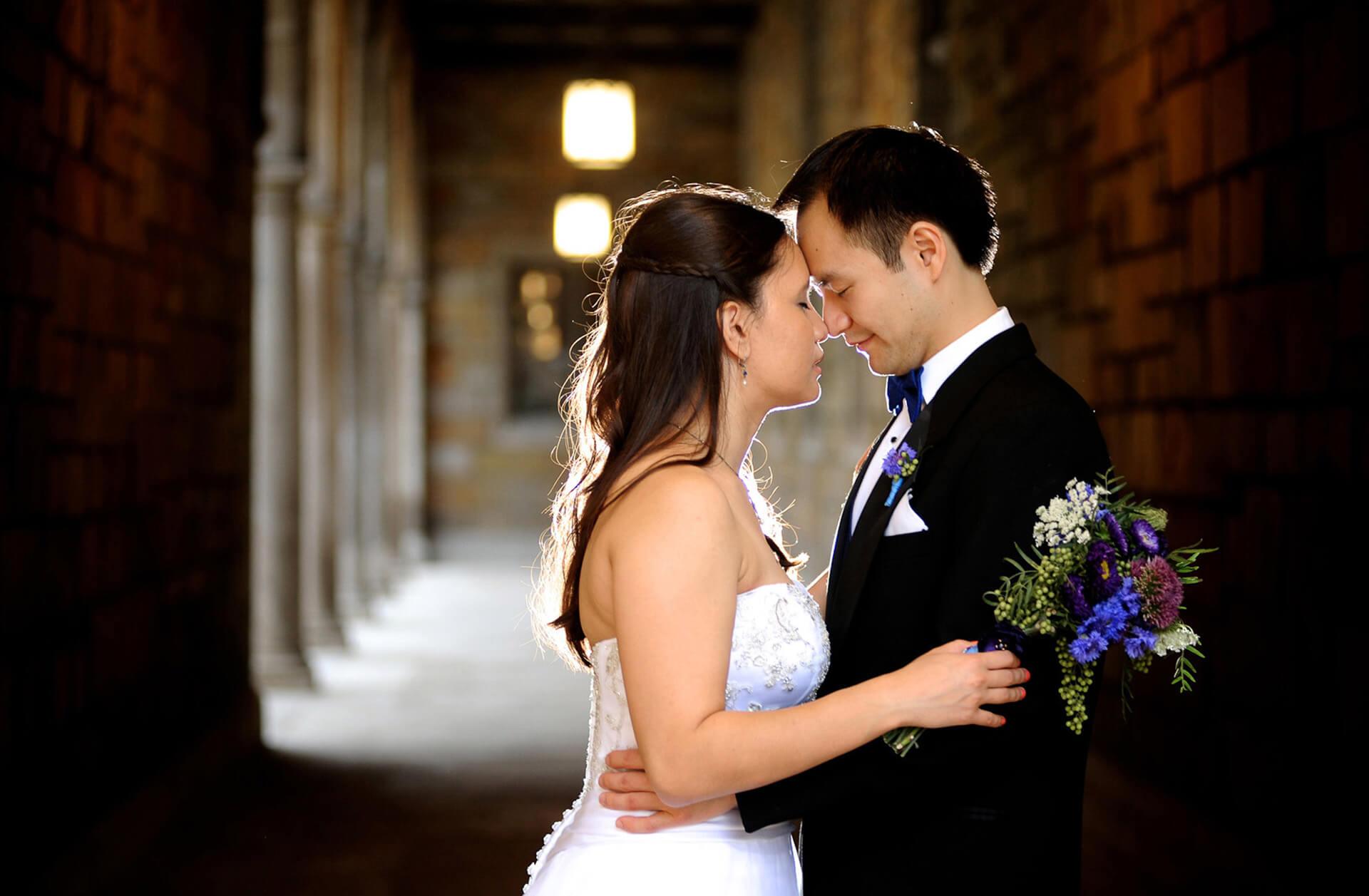 Michigan wedding photographer takes a photo of an Ann Arbor couples posing for photos a year after their Ann Arbor wedding.