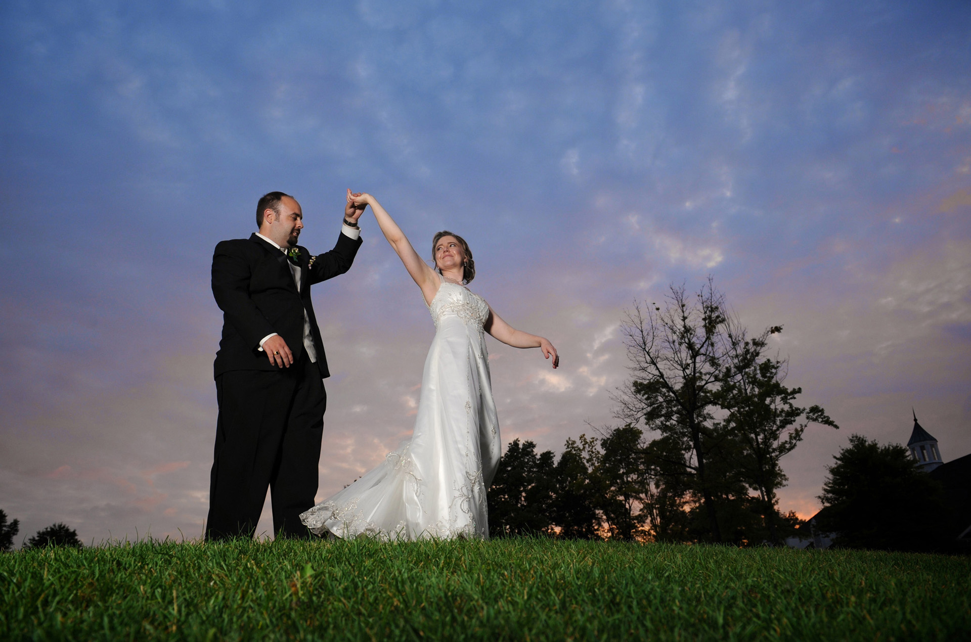 michigan wedding photographer shoots a couples portrait at Cherry Creek during their wedding reception
