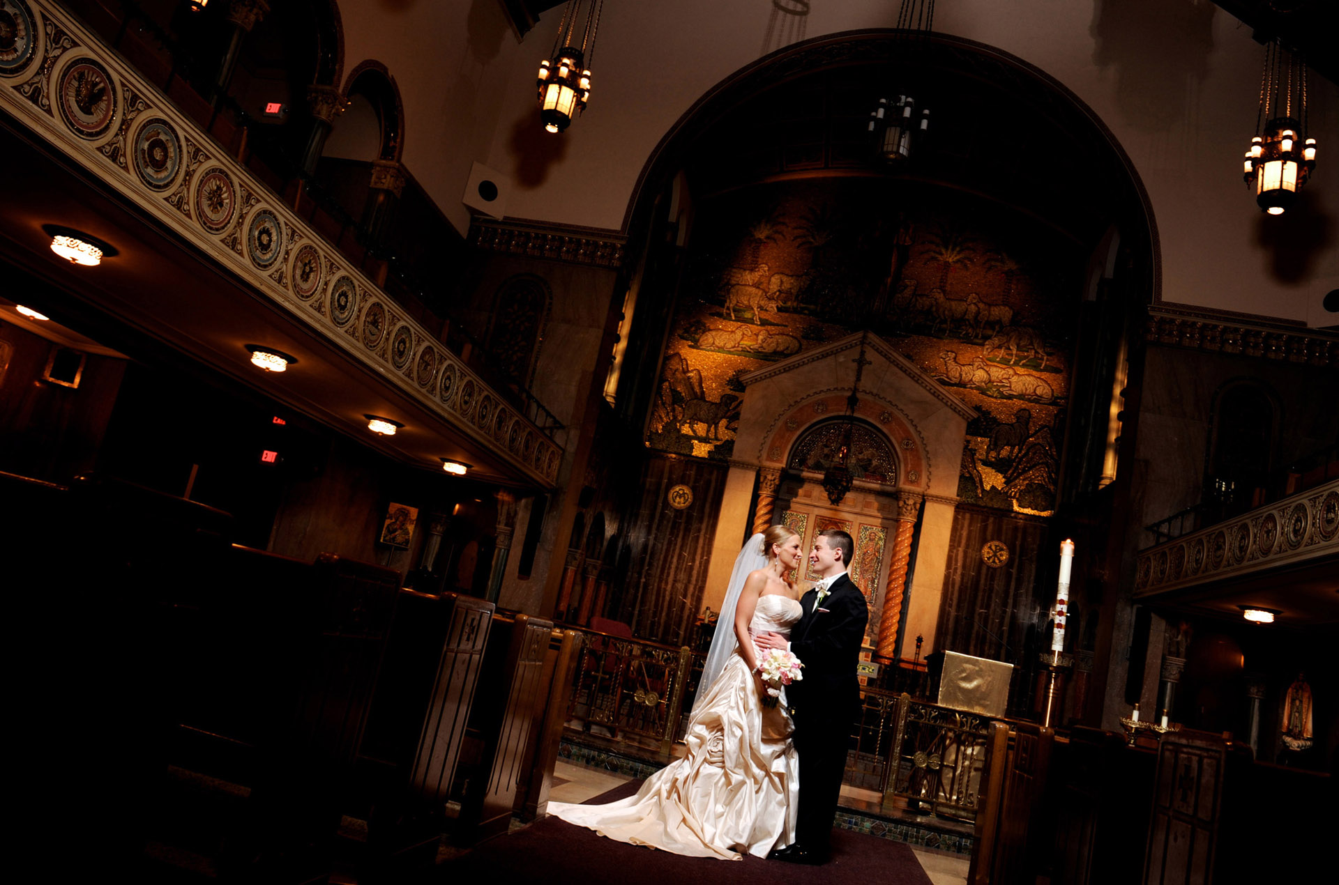 michigan wedding photographer takes a photo of a couple at St. Aloysius.