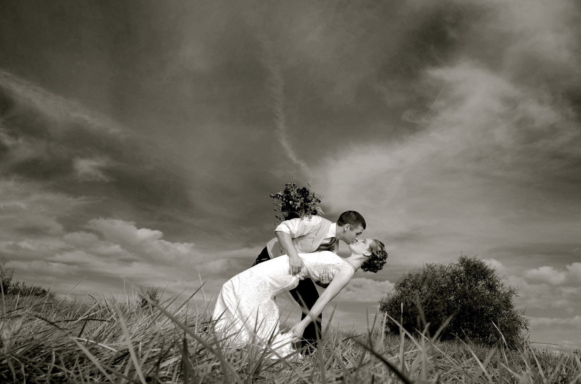 michigan wedding photographer takes dramatic portraits of a couple at their rustic wedding.