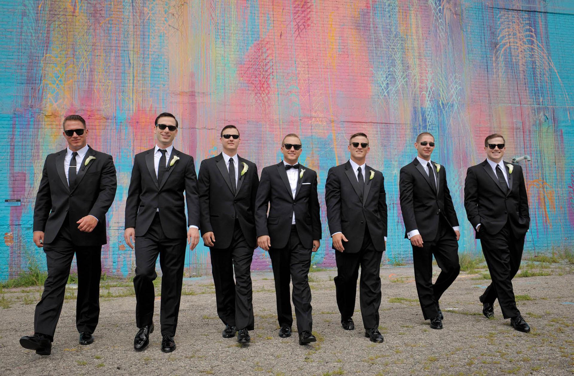 Groom and groomsmen do the walk away from the bleeding rainbow in Detroit, Michigan.