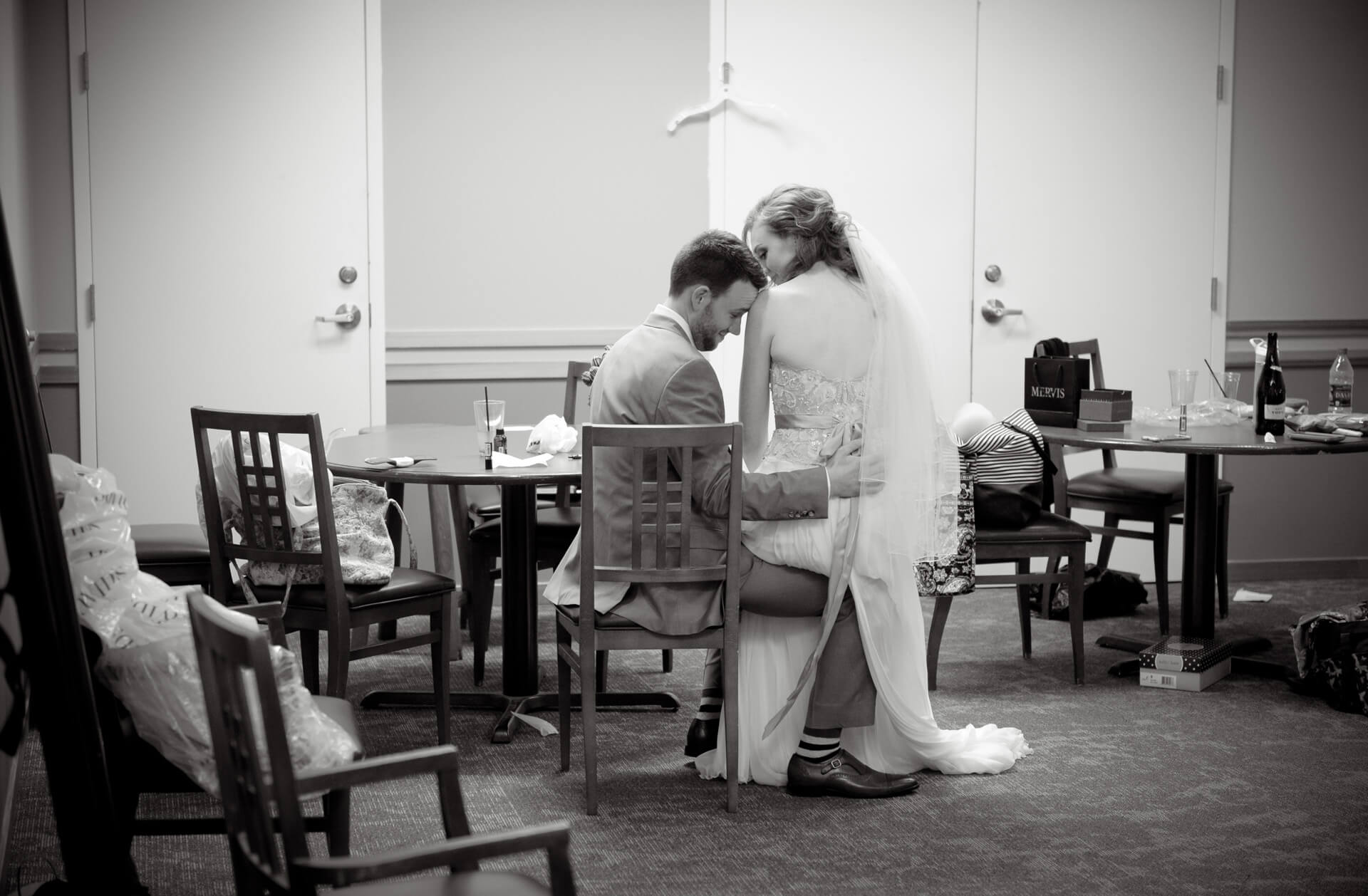 Documentary wedding photo of a bride and groom stealing away a few quiet moments away from their guests at the Stonebridge Golf Course in Ann Arbor, Michigan.