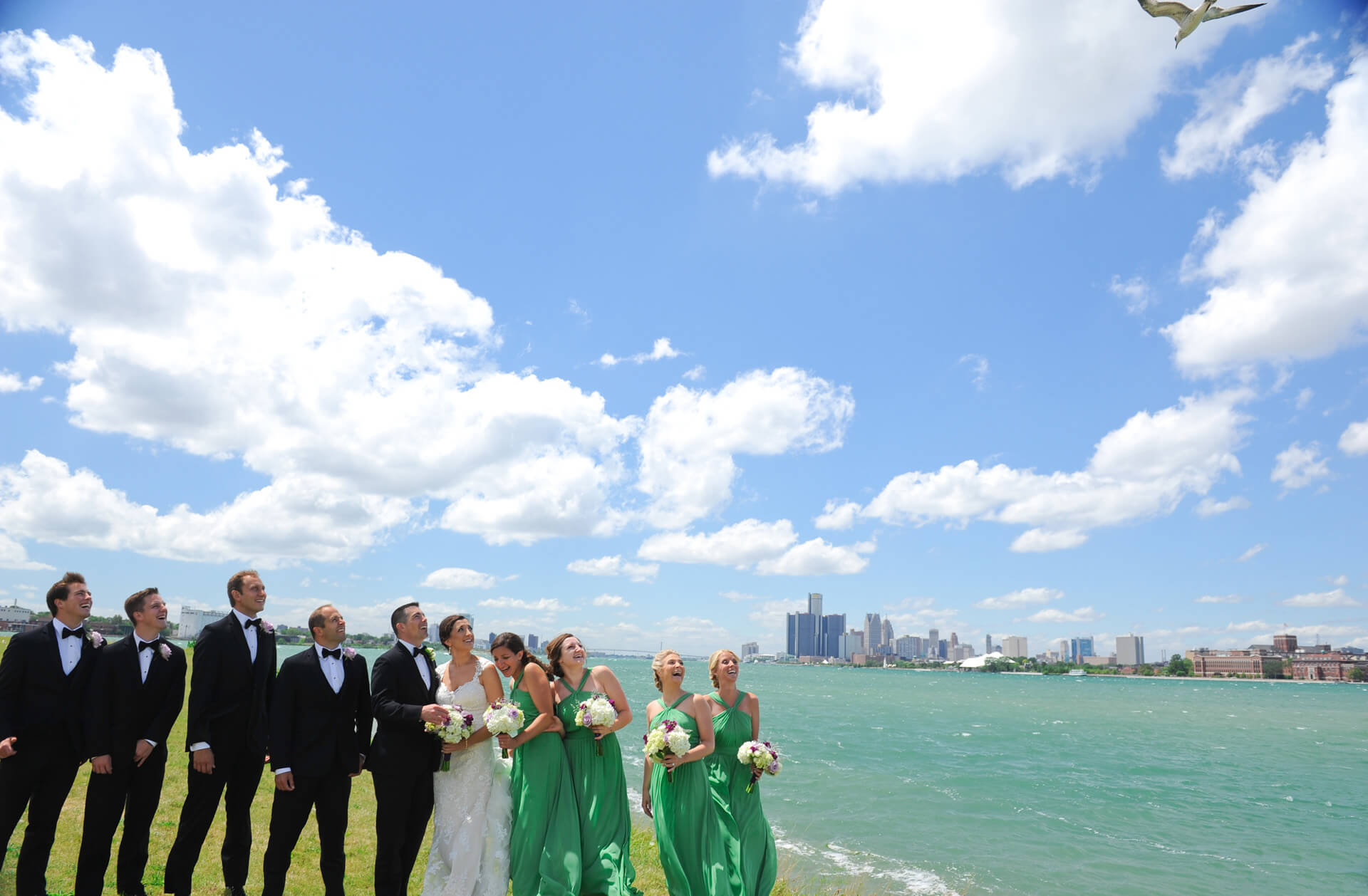Documentary wedding photo of the wedding party about to get pooped on my a seagull in Detroit, Michigan.
