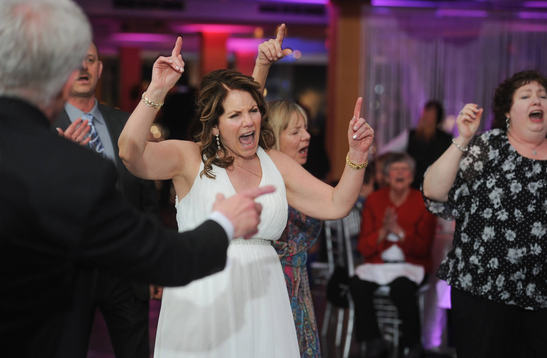 Documentary wedding photo of the bride dancing her heart of at her Roostertail wedding reception in Detroit, Michigan.