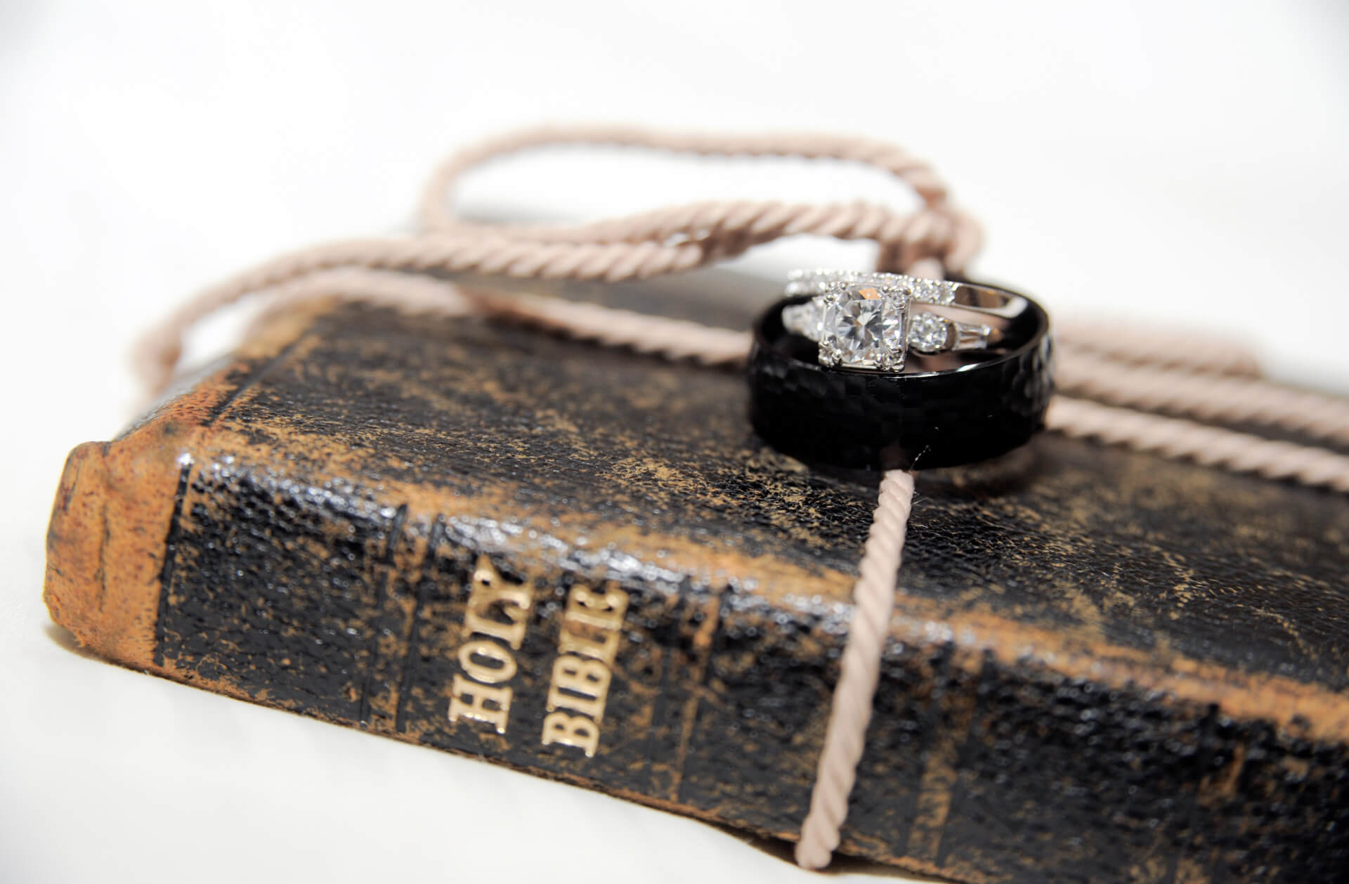 Epic Wedding portrait showing of the couple's family bible with their wedding rings at the Royal Park Hotel in Rochester, Michigan.