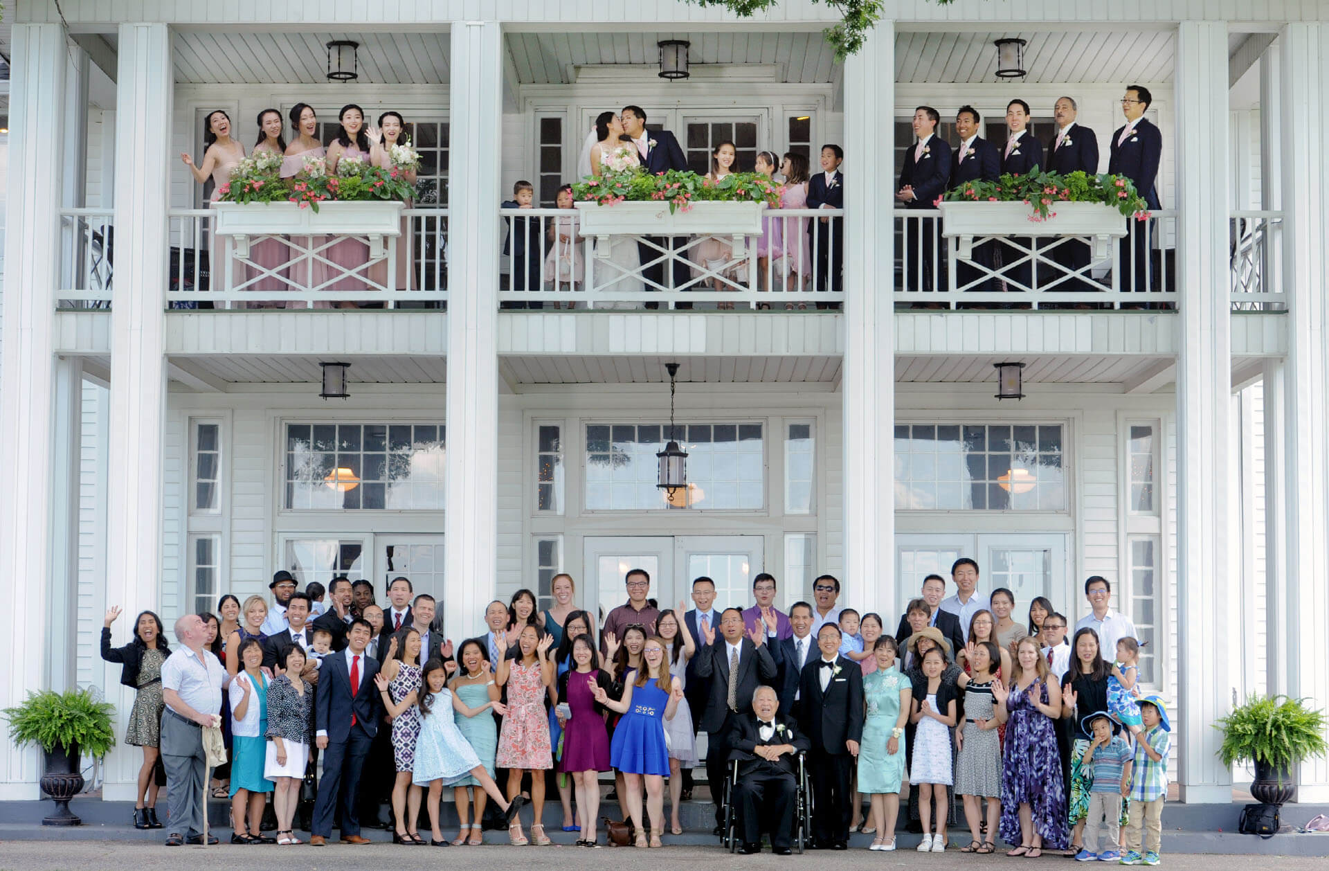 Epic Wedding portrait showing the entire wedding party and guests at Waldenwoods Resort in Howell, Michigan.