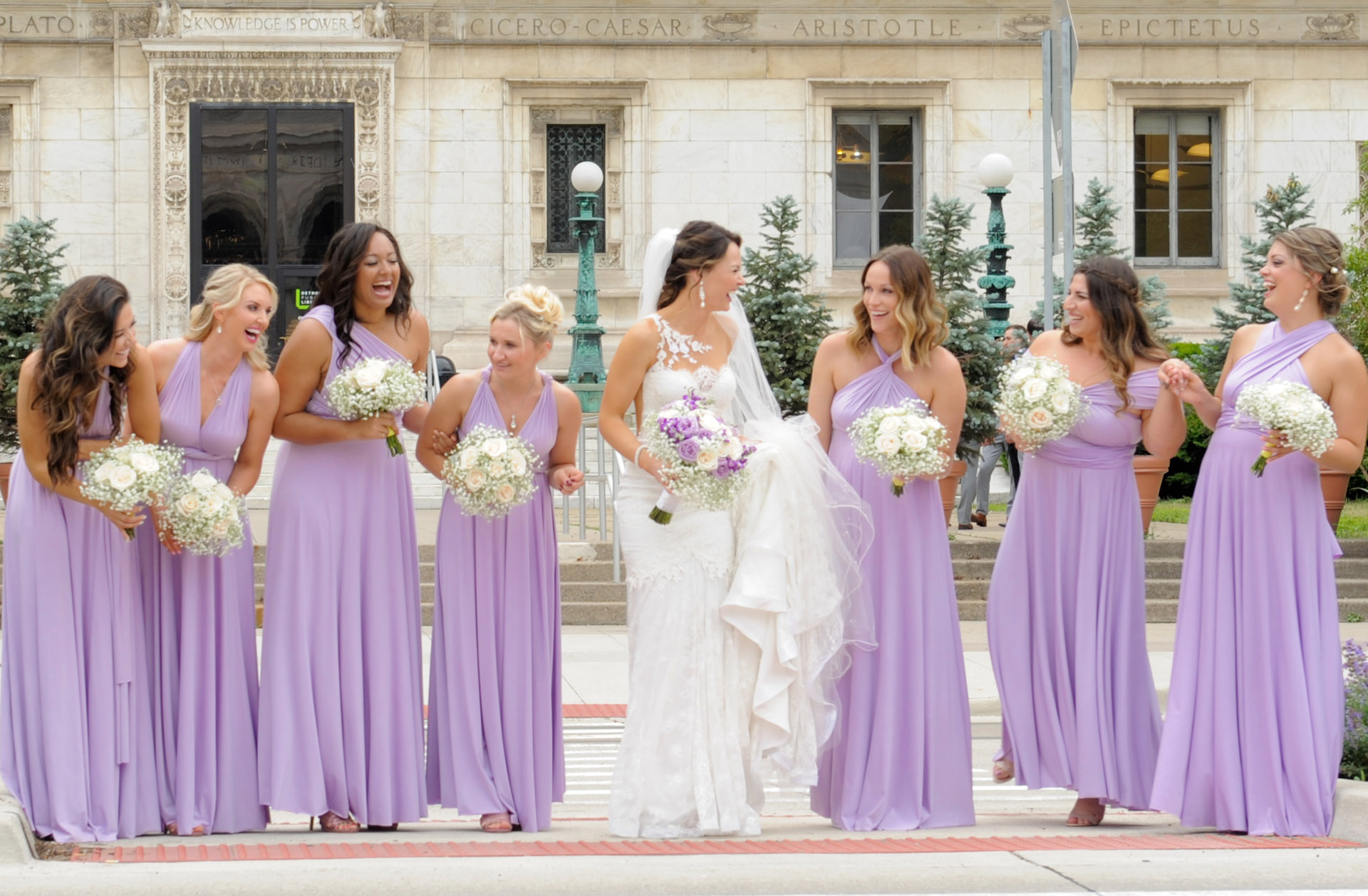 Epic Wedding portrait showing the bride and her bridesmaids heading across Woodward Avenue in Detroit, Michigan.