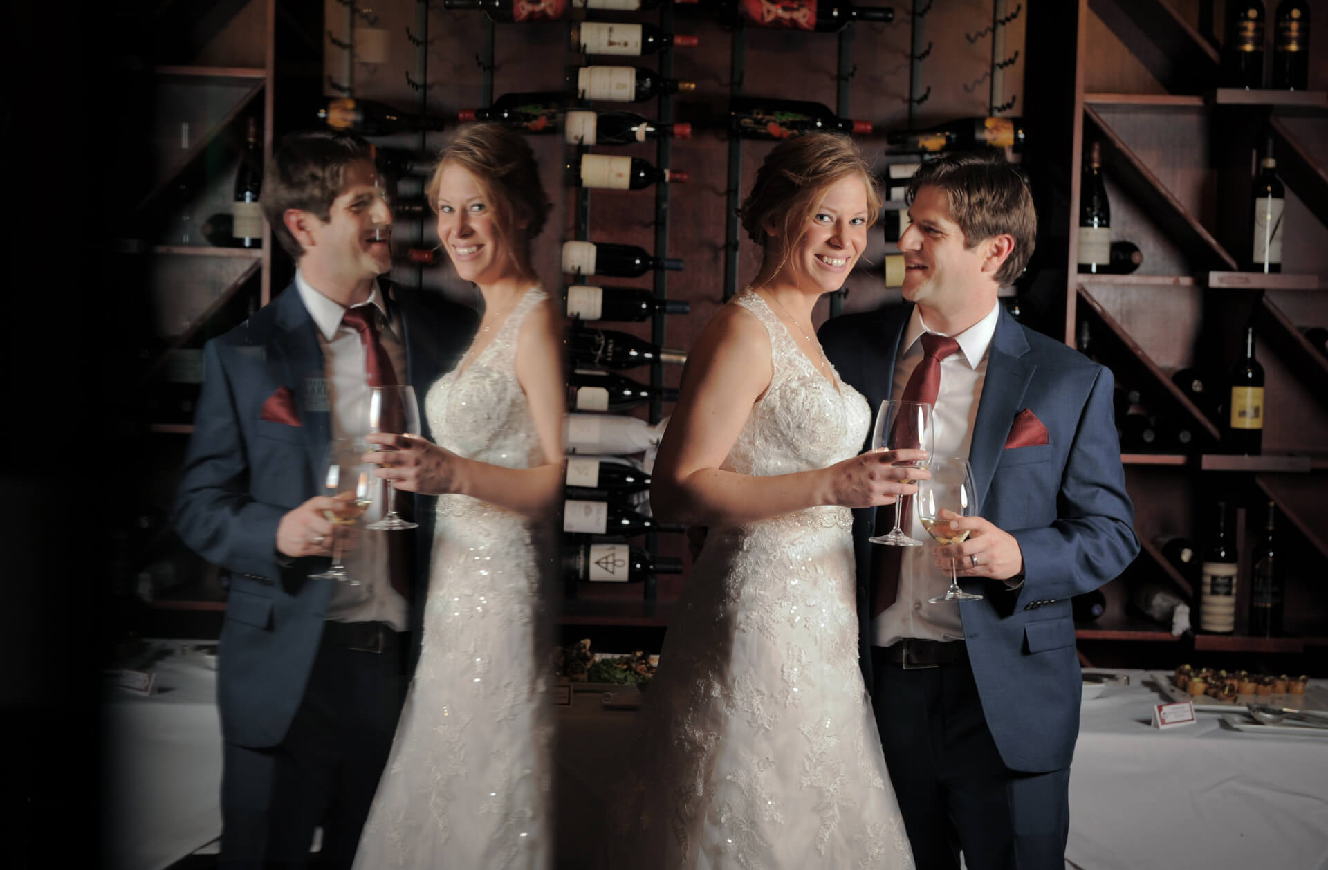 Epic Wedding portrait showing the bride and groom reflected in the wine vault at Vineology in Ann Arbor, Michigan.