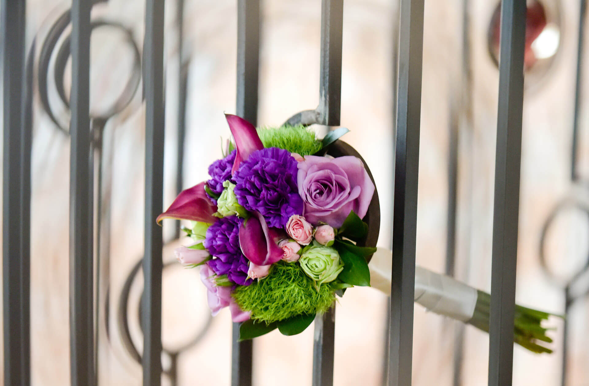 Epic Wedding portrait of the bride's bouquet sticking out of custom iron works at the Crofoot in Pontiac, Michigan wedding
