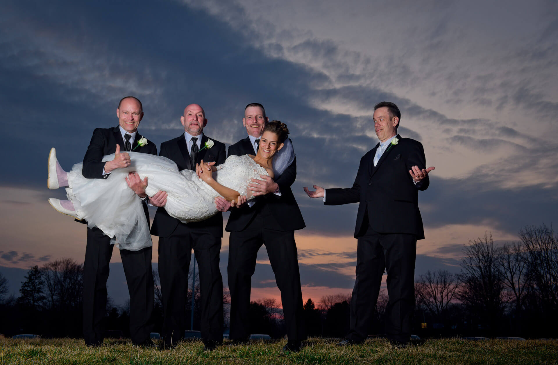 Epic Wedding portrait showing a groom who gets left out of the photo his groomsmen wanted to do at Tina's Country House in Maccomb, Michigan.