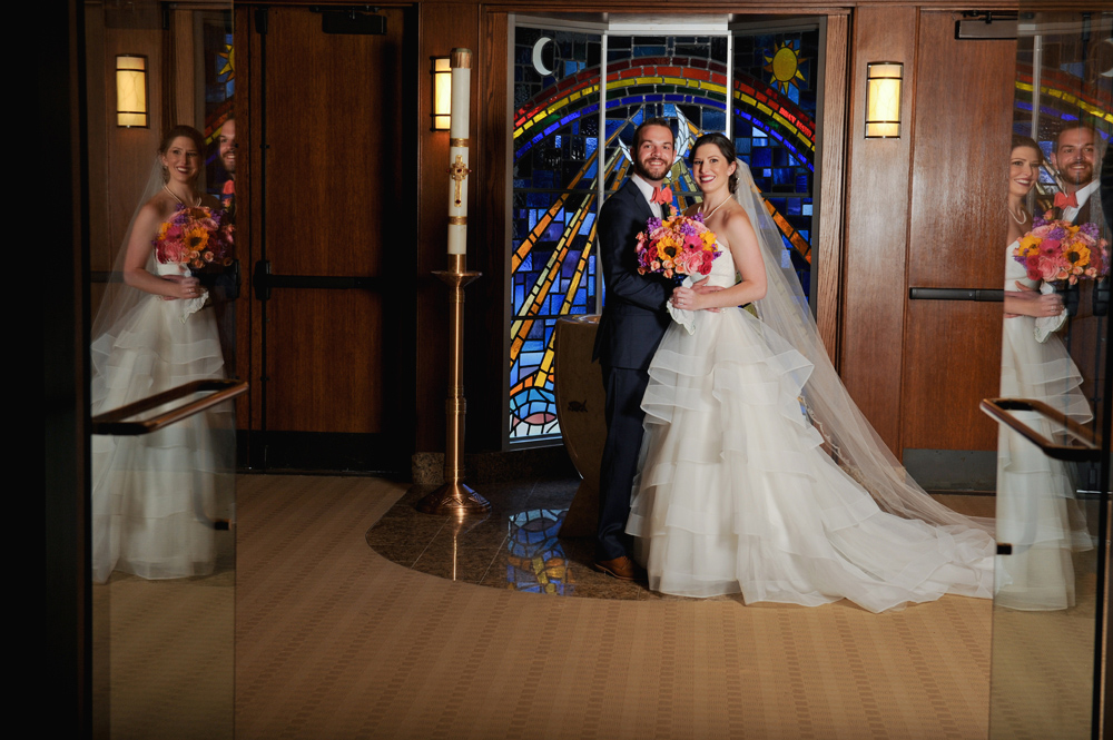 A Birmingham, Michigan wedding poses at Holy Name Catholic Church in Birmingham, MI on the wedding day.