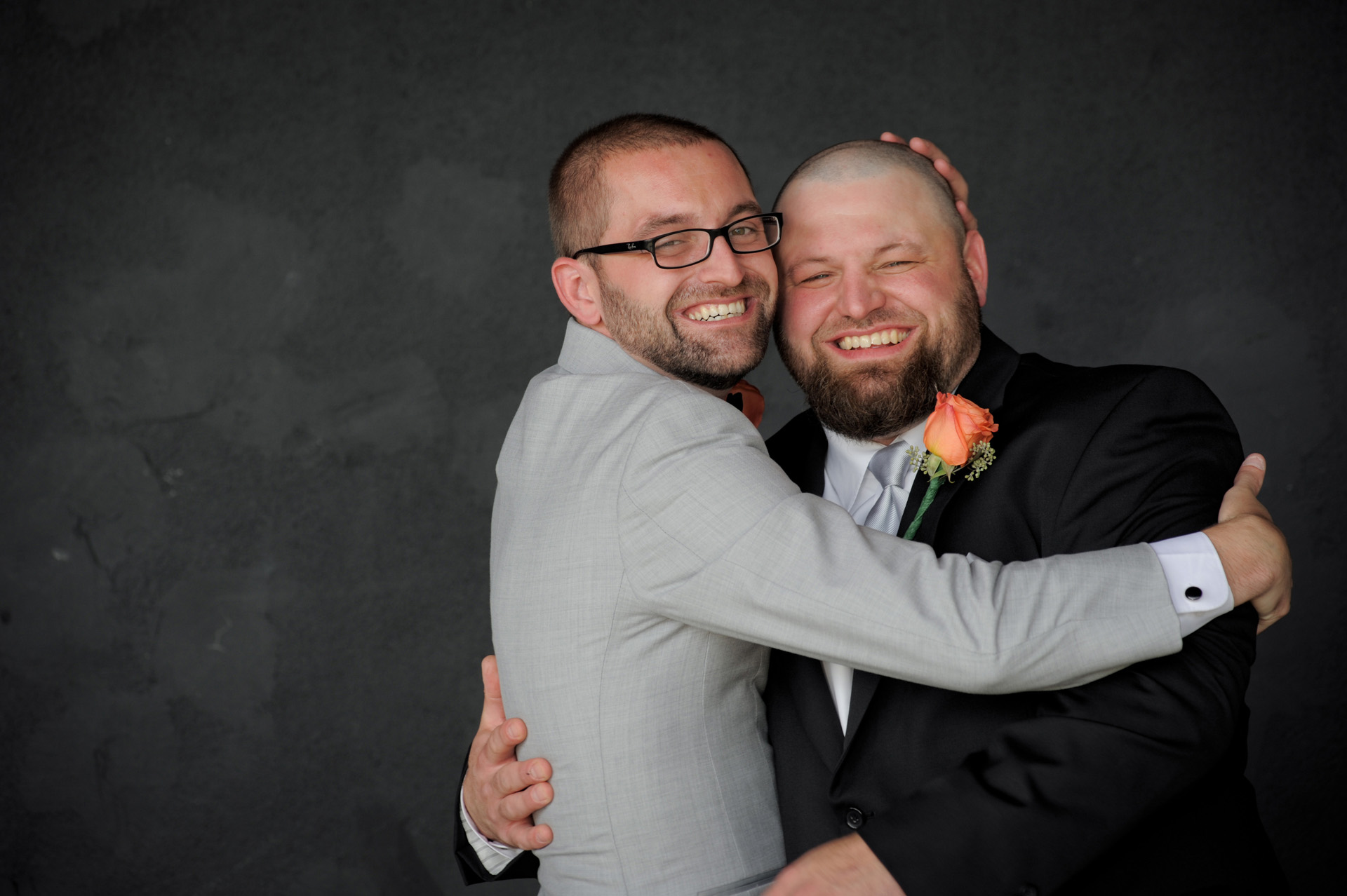 A family oriented wedding in Michigan features a groom and his brother goofing around during wedding party photos in Macomb County in Sterling Heights formerly known as the Sterling Inn.