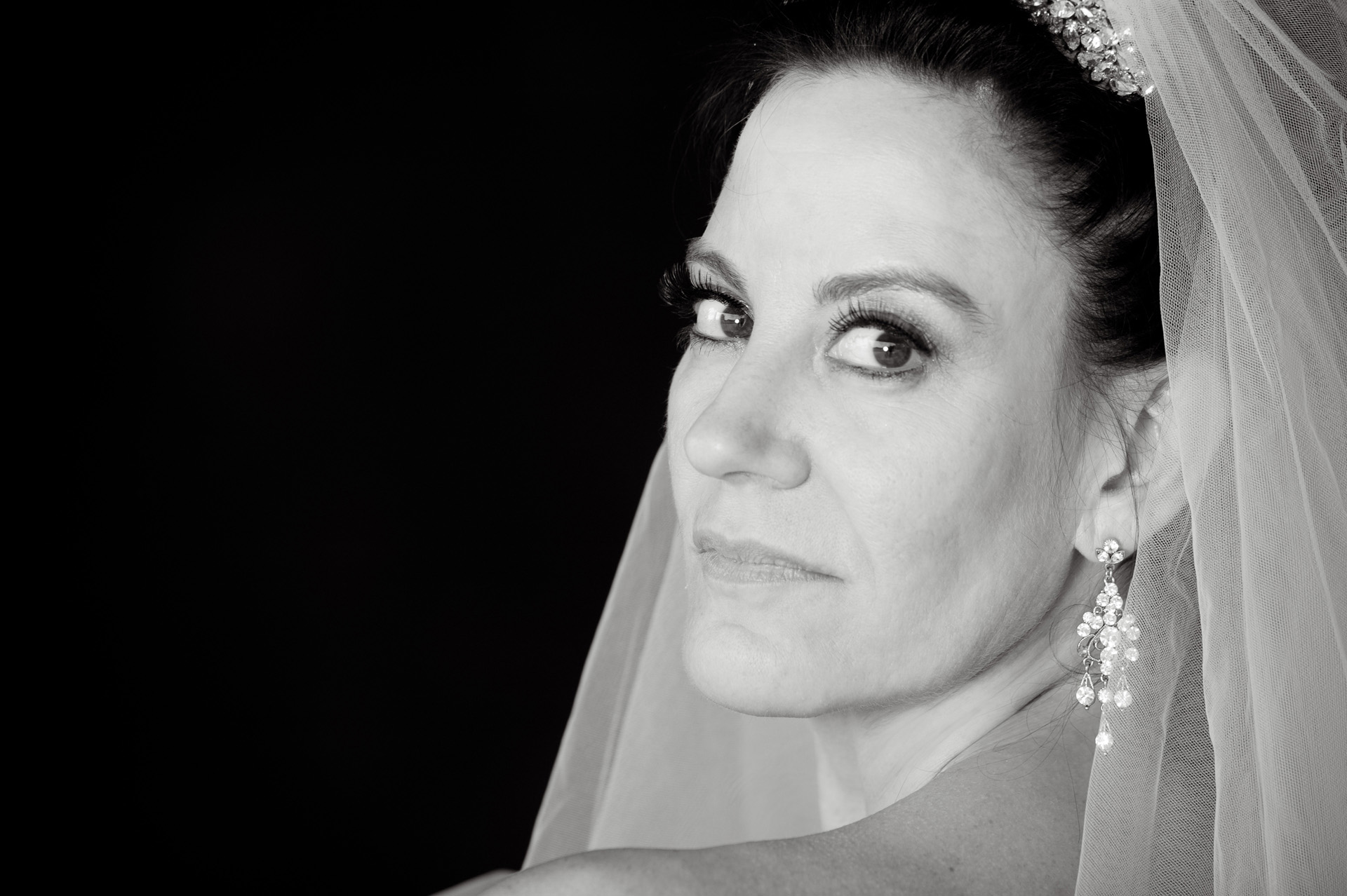 A family oriented wedding in Michigan features a bride in perfect light for a very quick photo shoot before her wedding at the Wyndham Garden Hotel in Sterling Heights, Michigan (formerly known as the Sterling Inn) in Macomb County, Michigan.