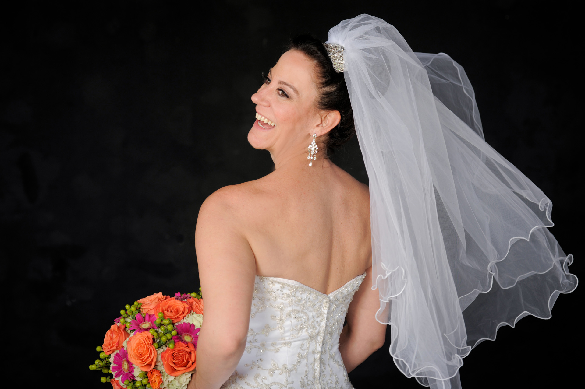 A family oriented wedding in Michigan features a bride in perfect light for a very quick photo shoot capturing fleeting moments before her wedding at the Wyndham Garden Hotel in Sterling Heights, Michigan (formerly known as the Sterling Inn) in Macomb County, Michigan.