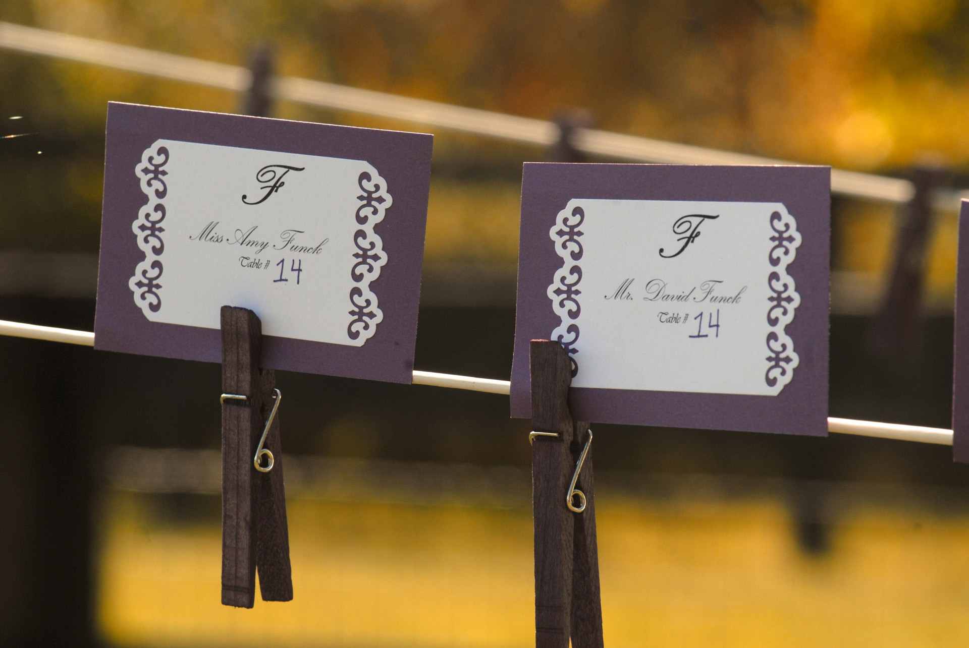 Favorite Michigan backyard wedding photography features photojournalist photos of guests name tags strung on a close line before a wedding in metro Detroit, Michigan featuring their lovely backyard garden wedding in fall.