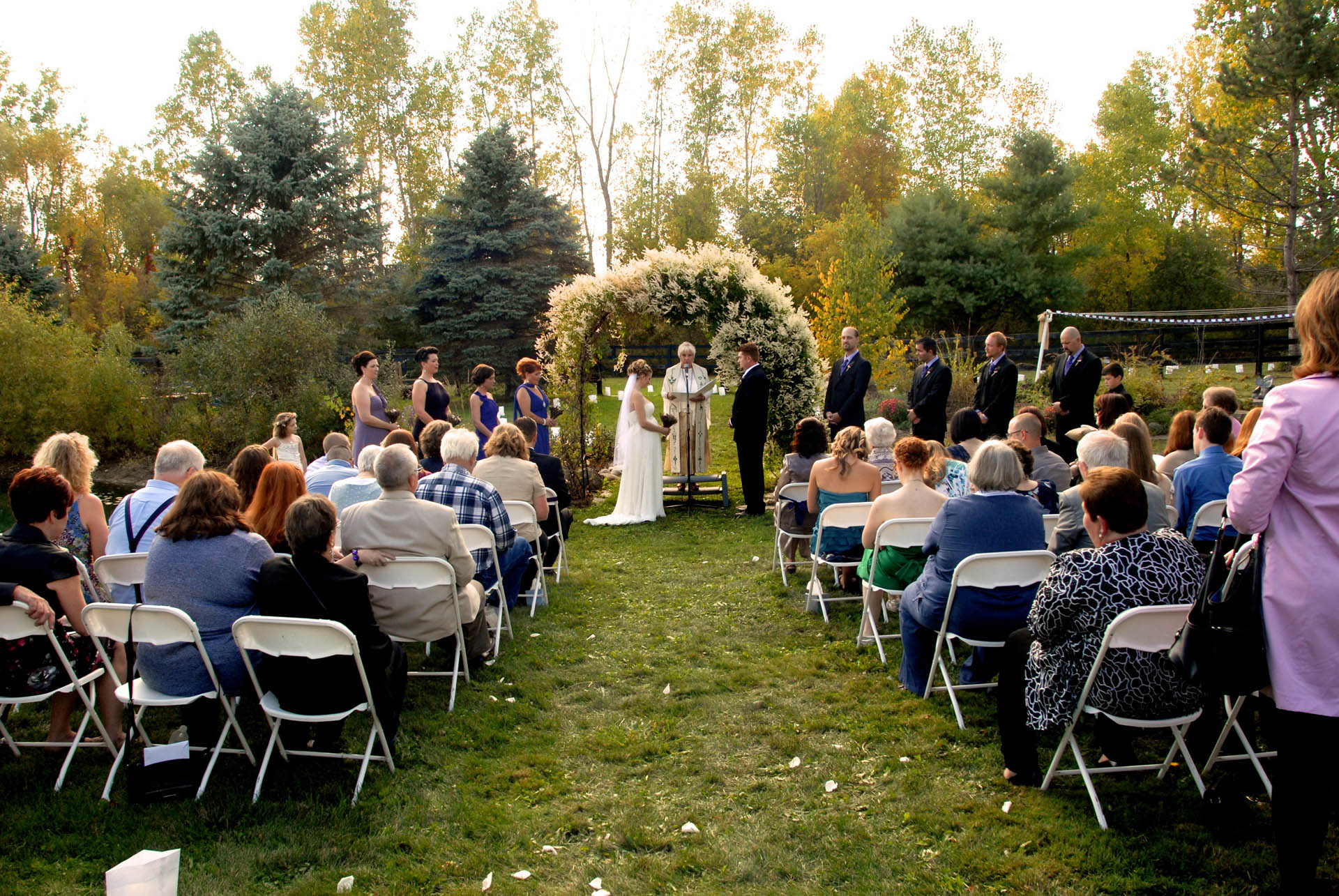Favorite Michigan backyard wedding photography features photojournalist photos of  and overview of what a nice garden style wedding might look like in metro Detroit, Michigan featuring their lovely backyard garden wedding in fall.