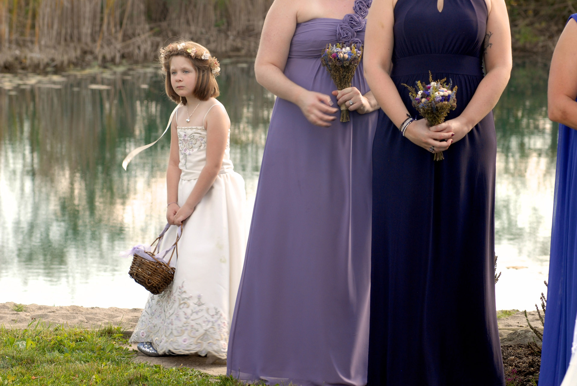 Best Michigan backyard wedding photography features photojournalist photos of a bored flower girl no longer interested in the wedding ceremony in metro Detroit, Michigan featuring their lovely backyard garden wedding in fall.
