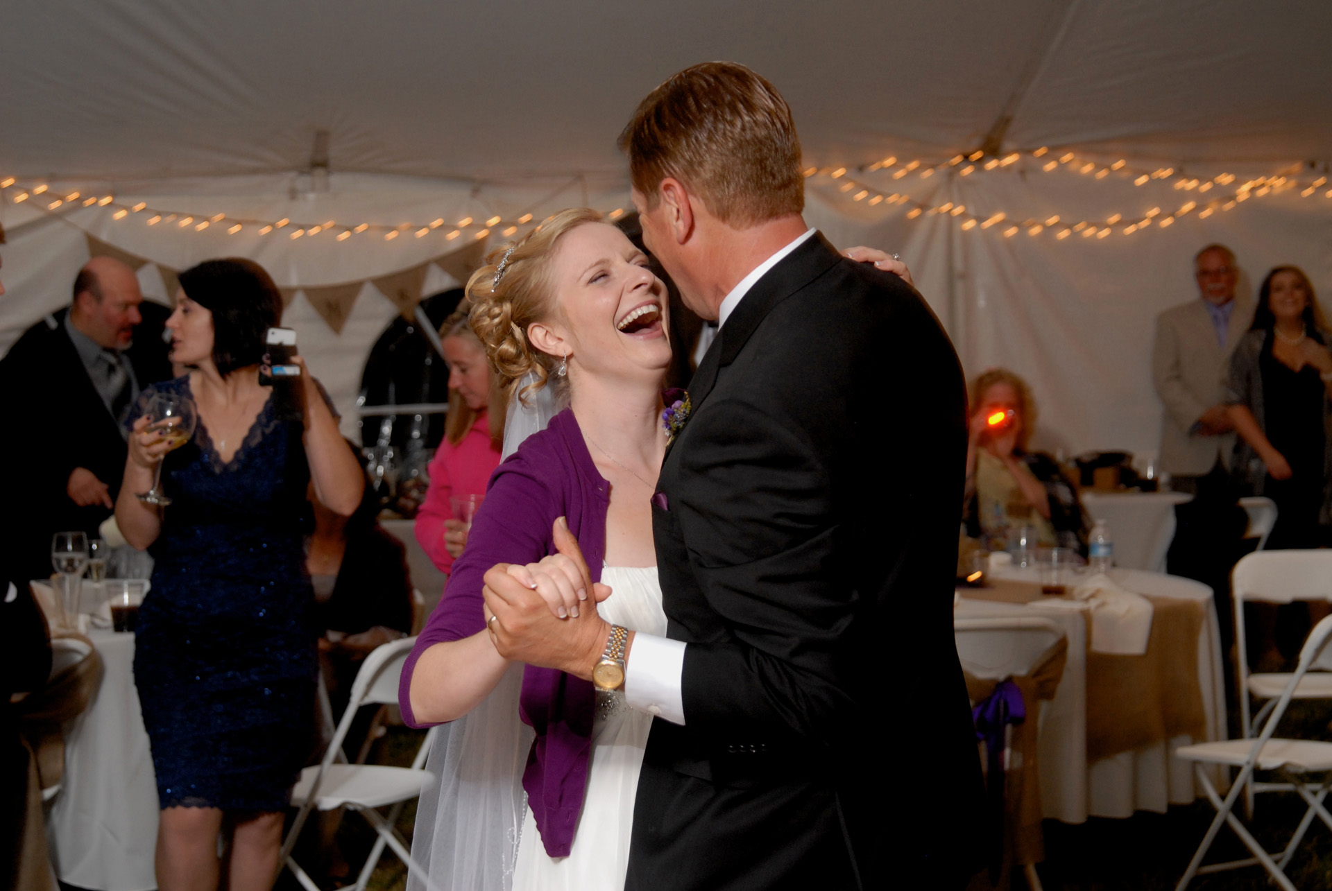 Best Michigan backyard wedding photography features photojournalist photos of the bride and her father dancing their first dance in metro Detroit, Michigan featuring their lovely backyard garden wedding in fall.