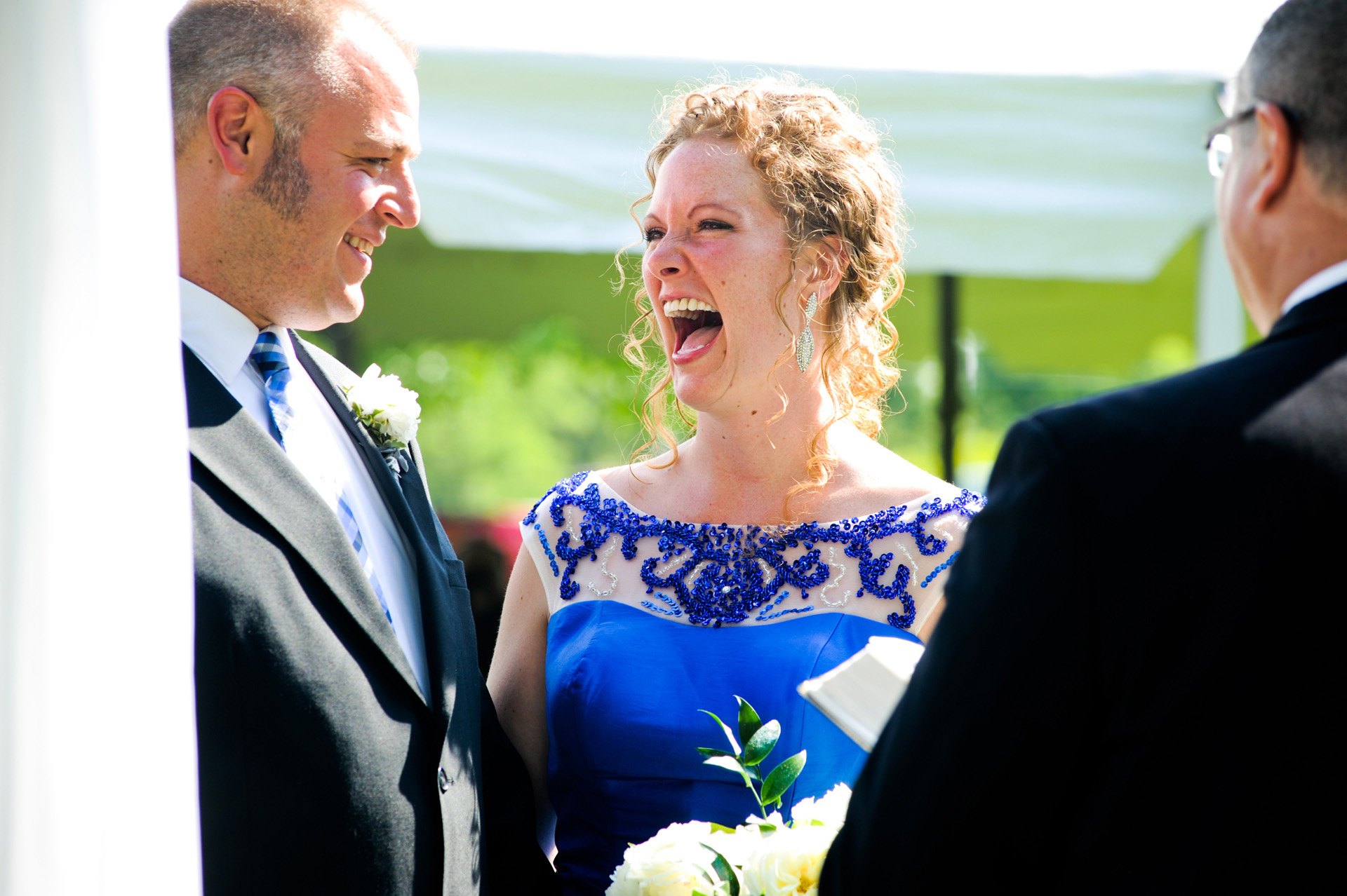budget conscience brides featuring contemporary and Pinterest worthy wedding photographs in Michigan highlights moving away from Pinterest to creating your unique wedding photography showing the bride and groom sharing a laugh and a moment during their Michigan wedding that emphasized photojournalist's moments and kept the bride on her budget.