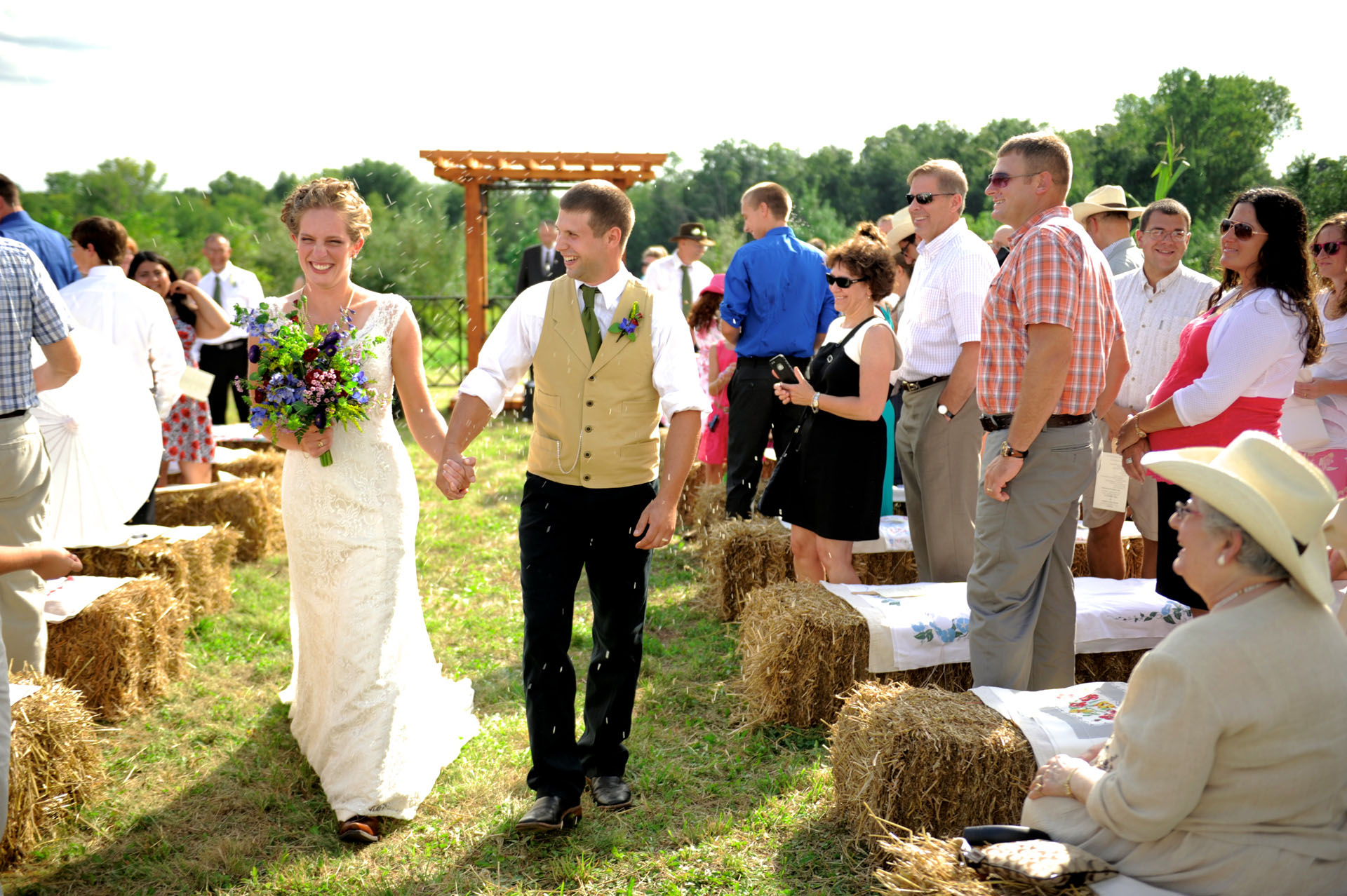 Michigan country wedding wedding photographer took a nice candid of the couple as the are pelted with rice at their country farm wedding in Michigan.